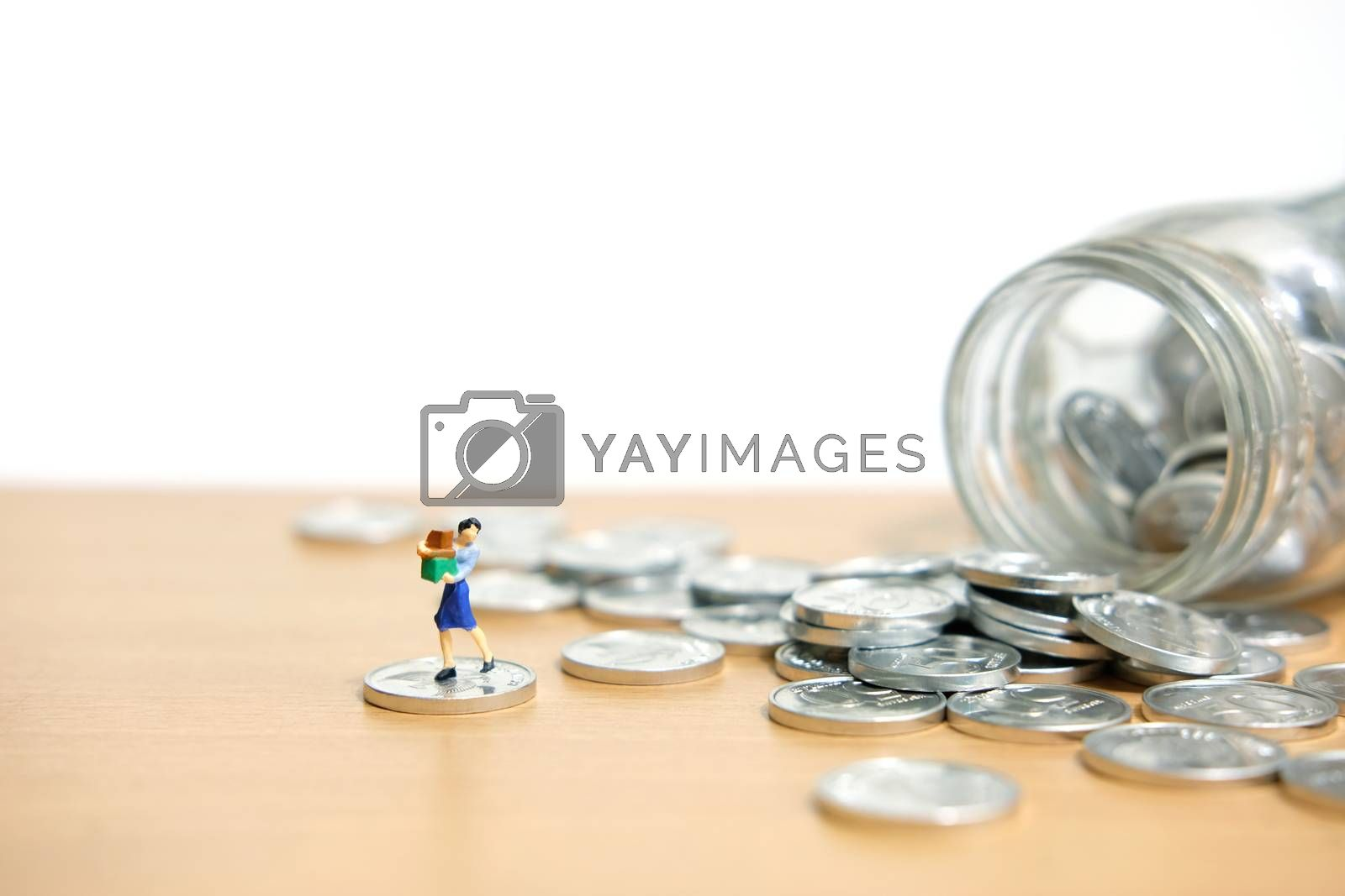 monthly expenditure, women spend savings to shop. Miniature people figure conceptual photography.
