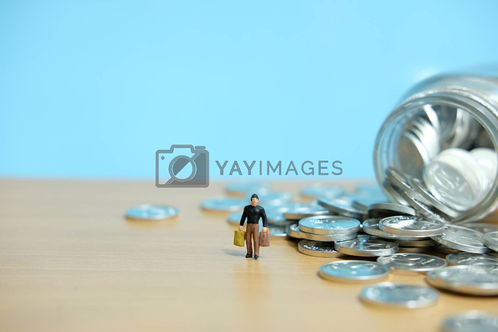 monthly expenditure, Men spend savings to shop. Miniature people figure conceptual photography.