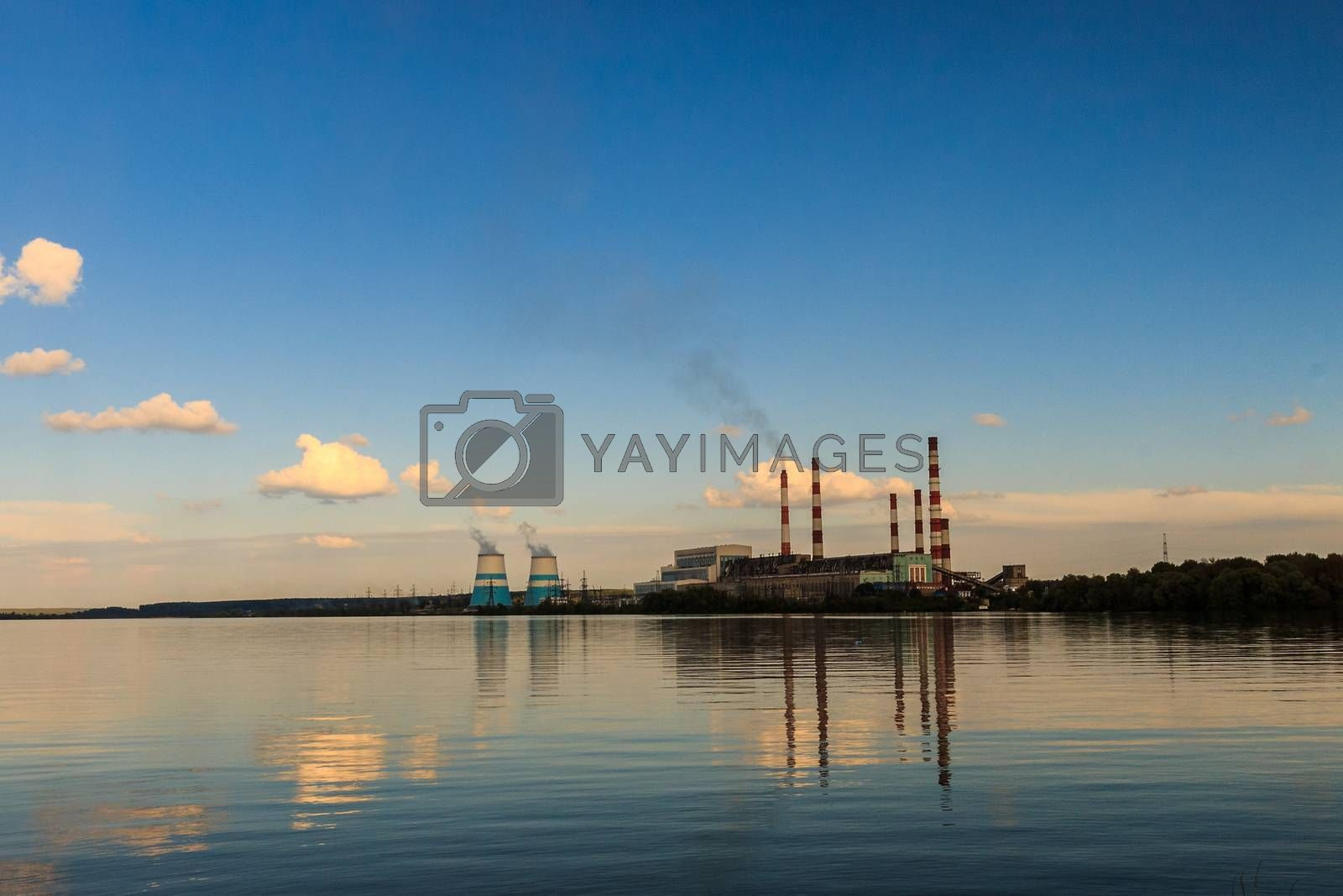 hydro power plant with reservoir and blue sky background