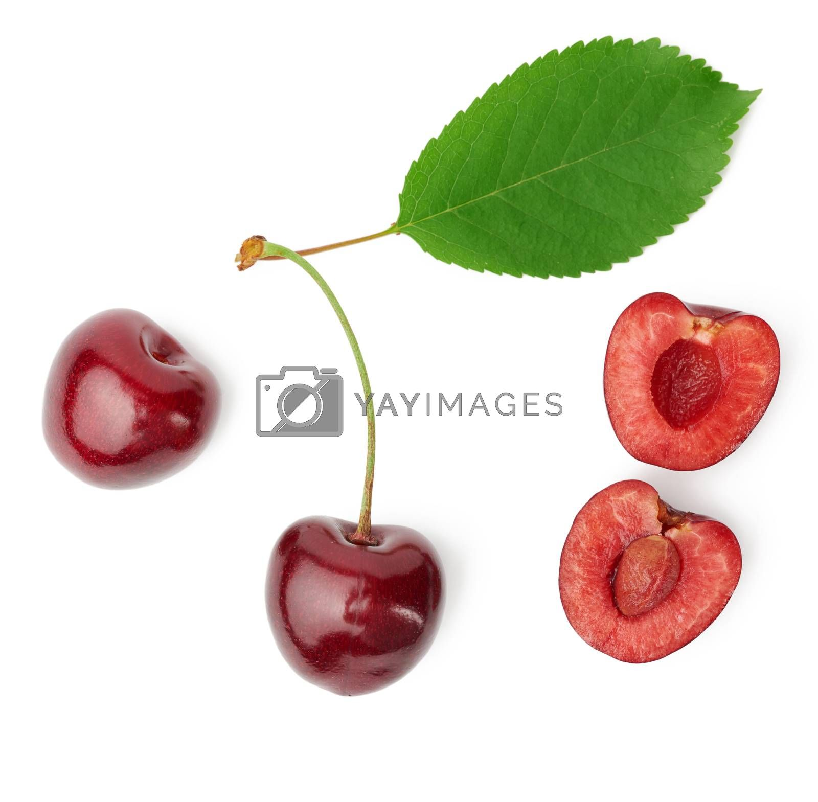whole ripe red juicy sweet cherries and halves with pits isolated on a white background, top view