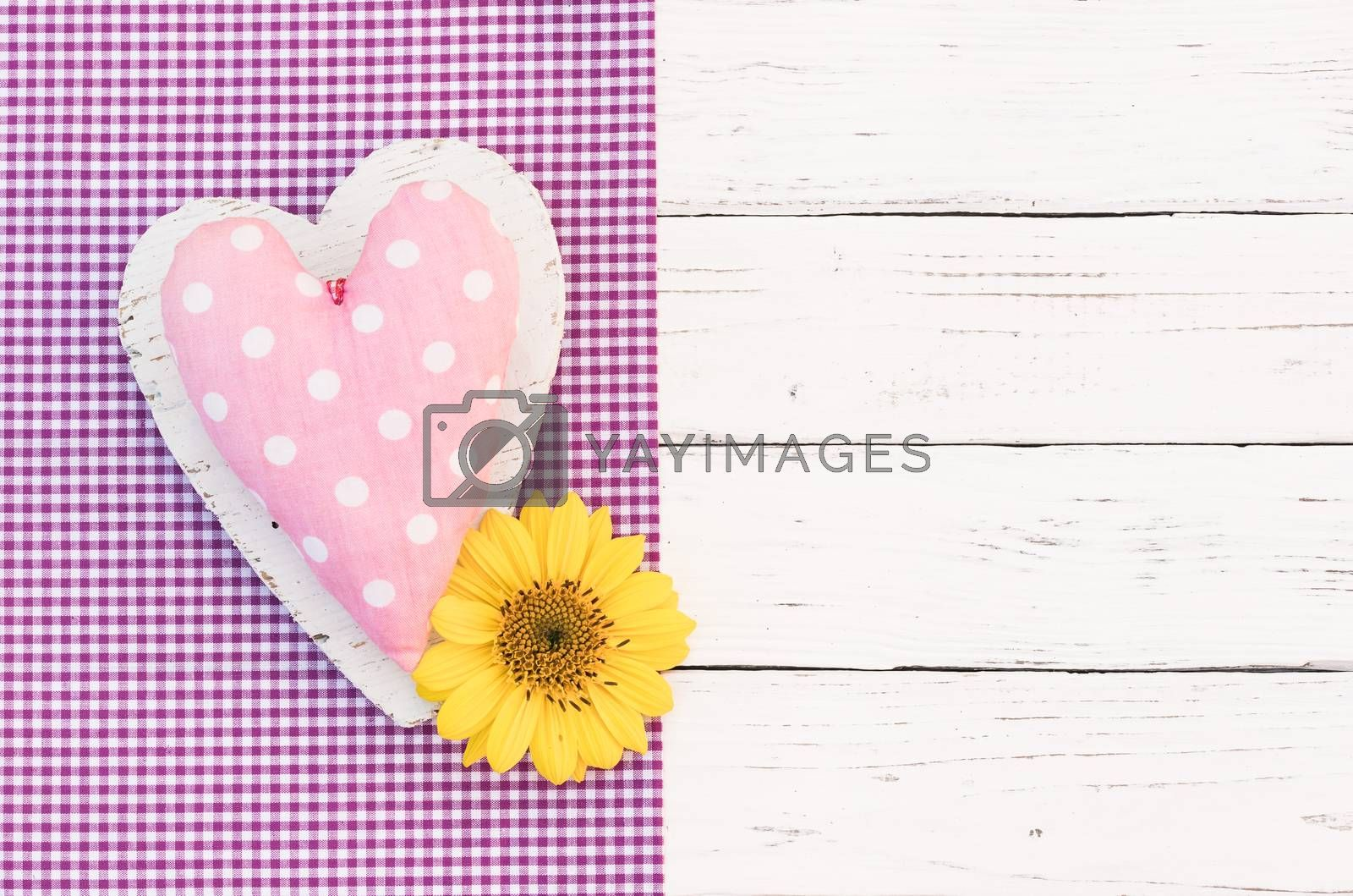 Romantic pink heart with blossom on white wooden background with copy space