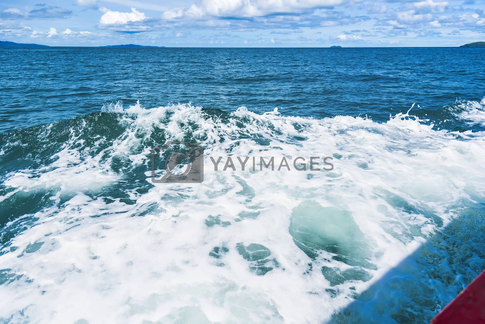 Water blue ocean splash and boat in the sea way ,Waves splashing on the side of ship