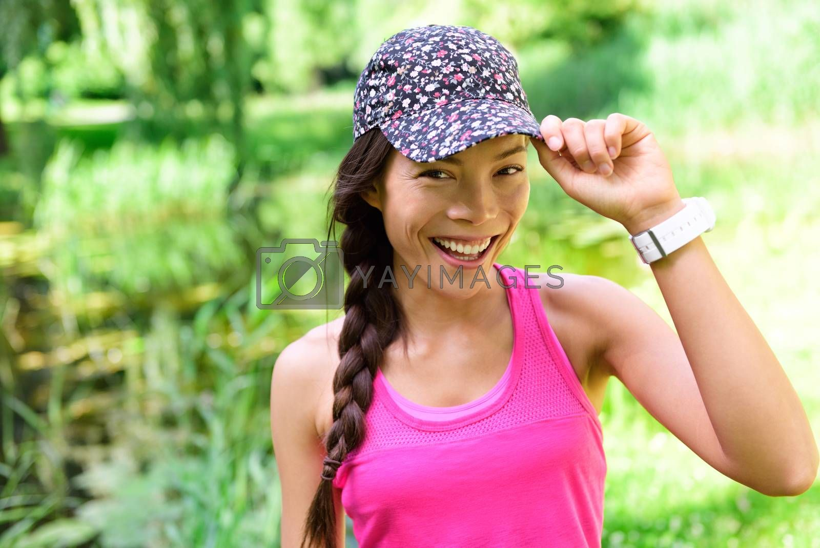 Portrait of woman runner wearing running cap by Maridav