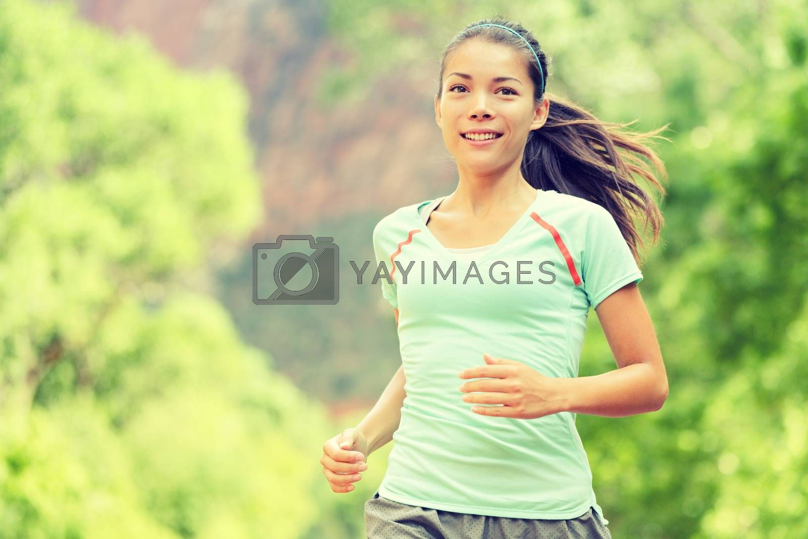 Young Woman Jogging In Park by Maridav