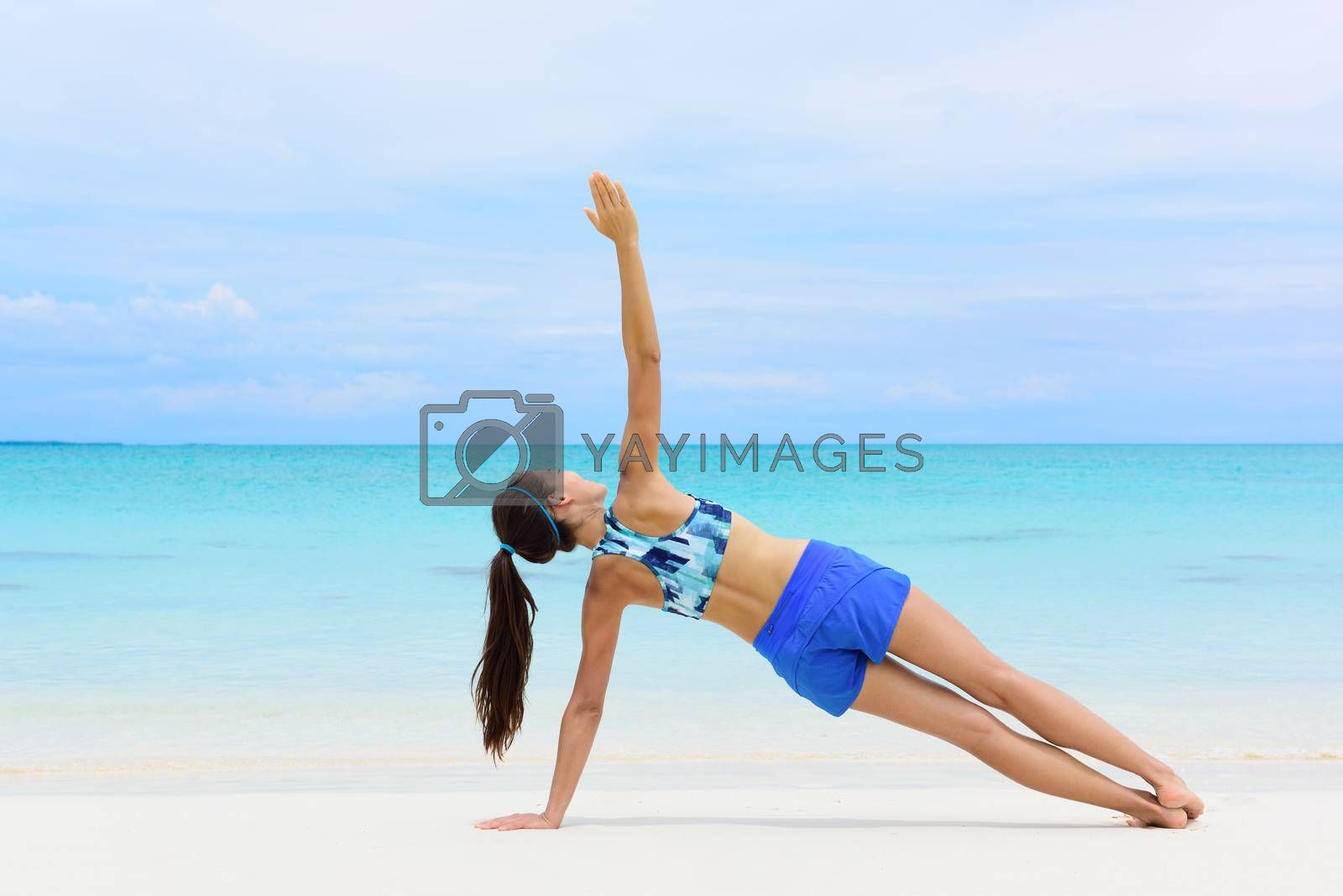 Fitness woman strength training core side plank by Maridav