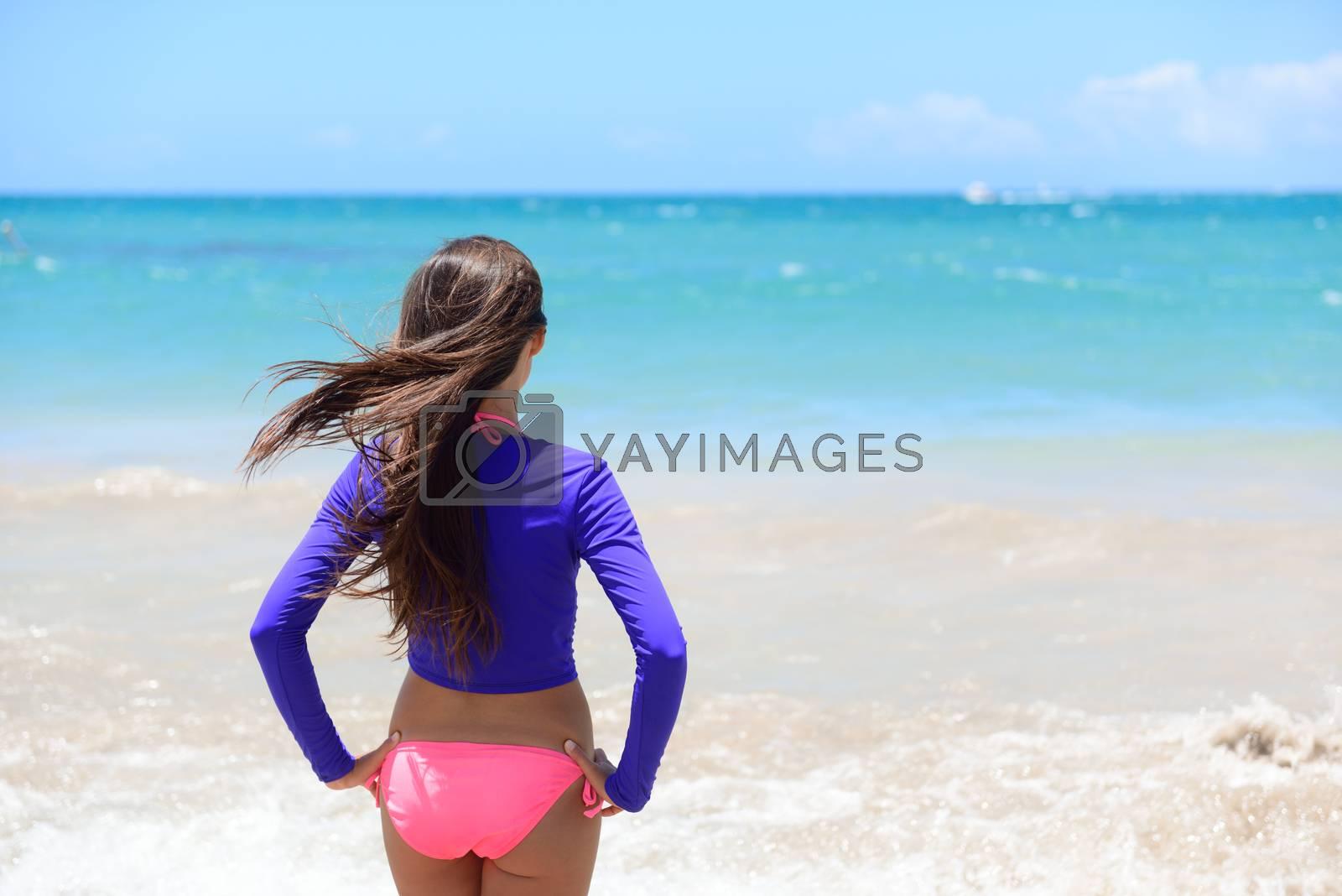 Beach girl going swimming in rash guard swim shirt by Maridav