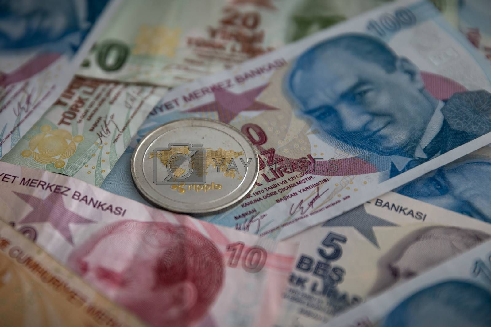 Bunch of Various Turkish Lira Banknotes and Ripple Coin