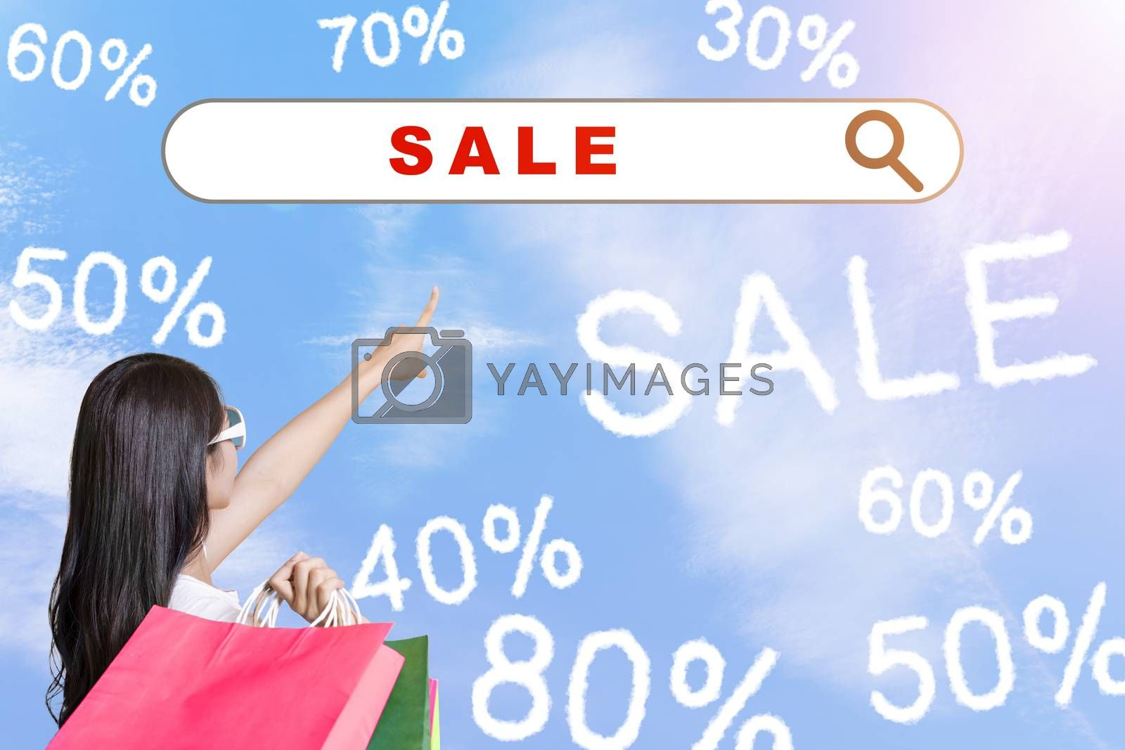 young woman holding shopping bags and internet shopping  technology concept