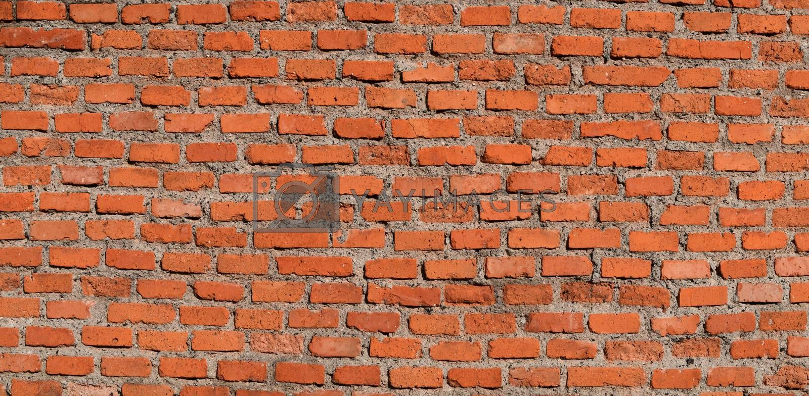 The red brick wall, rough and irregular background. Brick texture.