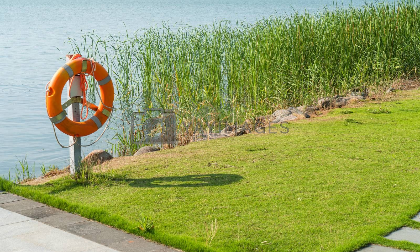 The life buoy by the lake in a public park. Photo in Suzhou, China.