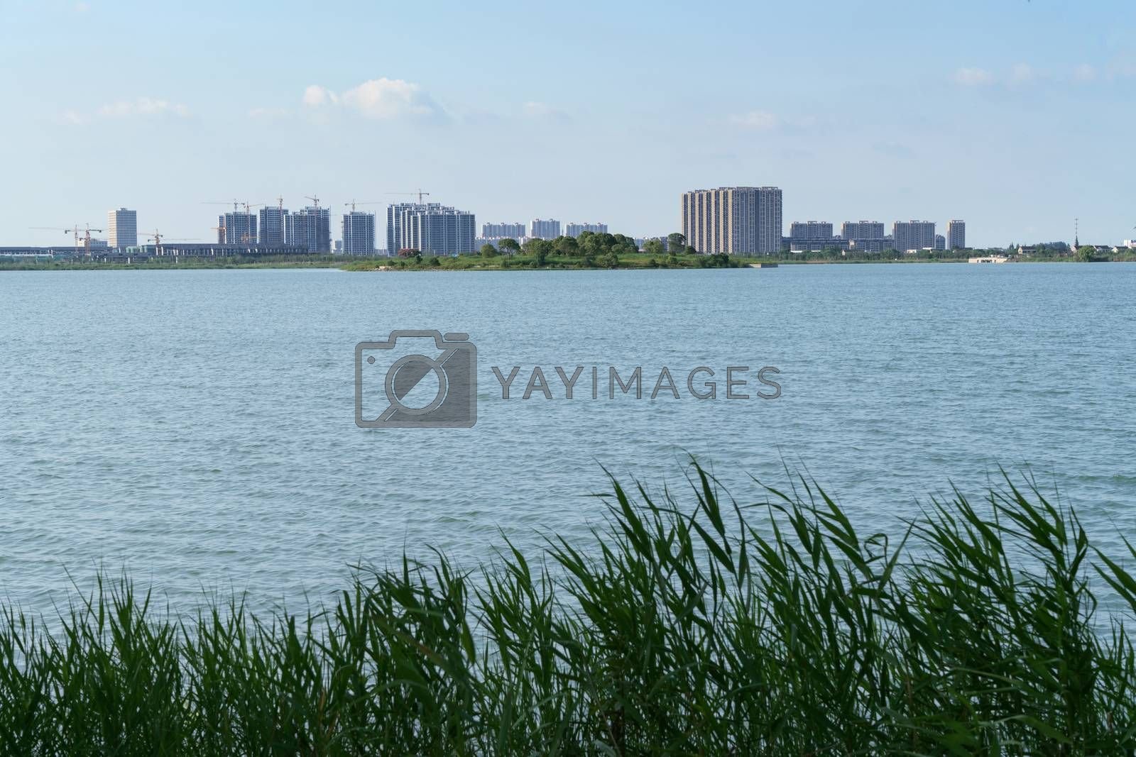 The city on the opposite side of the lake. Photo in Suzhou, China.