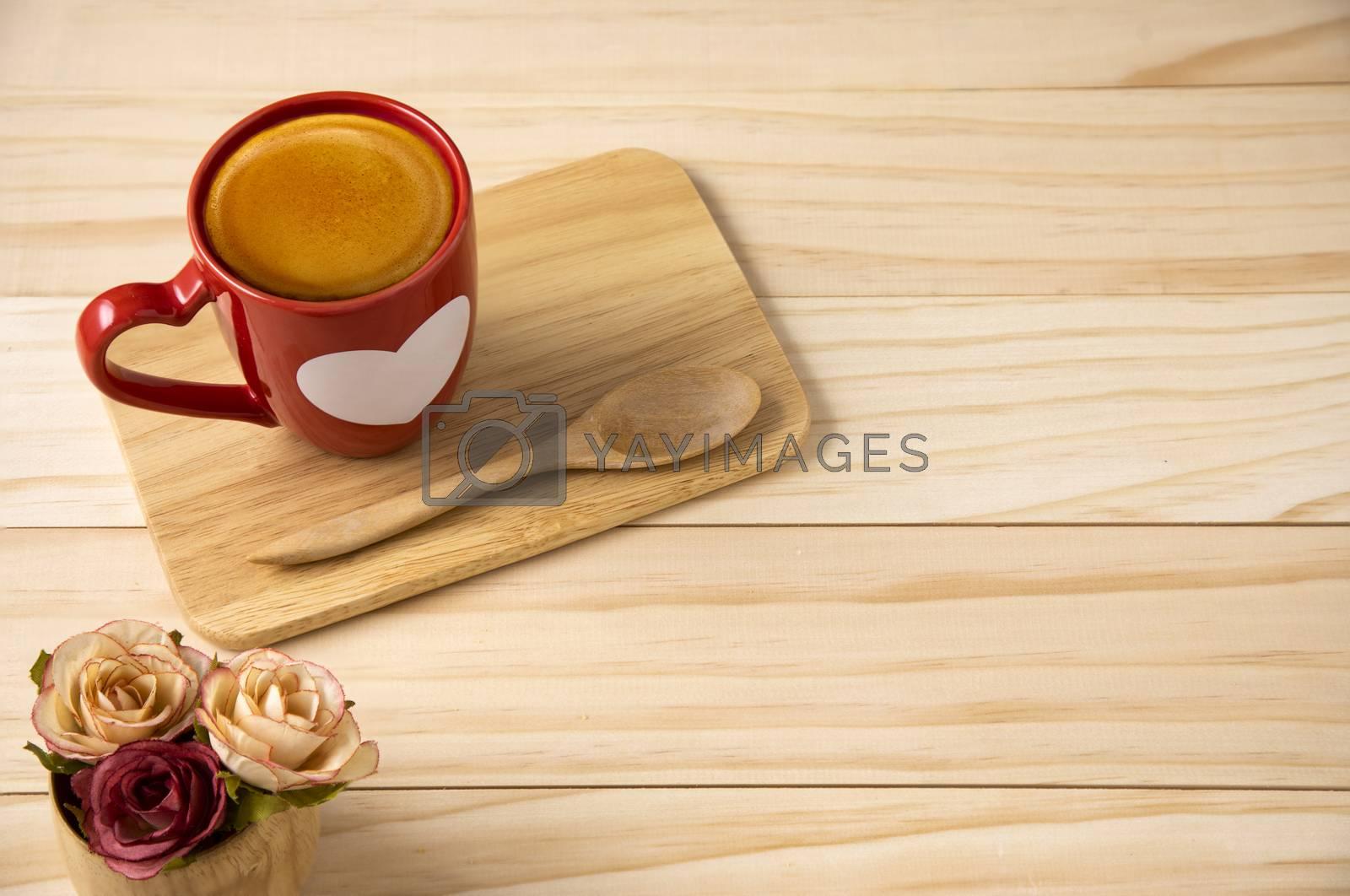 Al burgundy coffee mug on a table. Top down view.