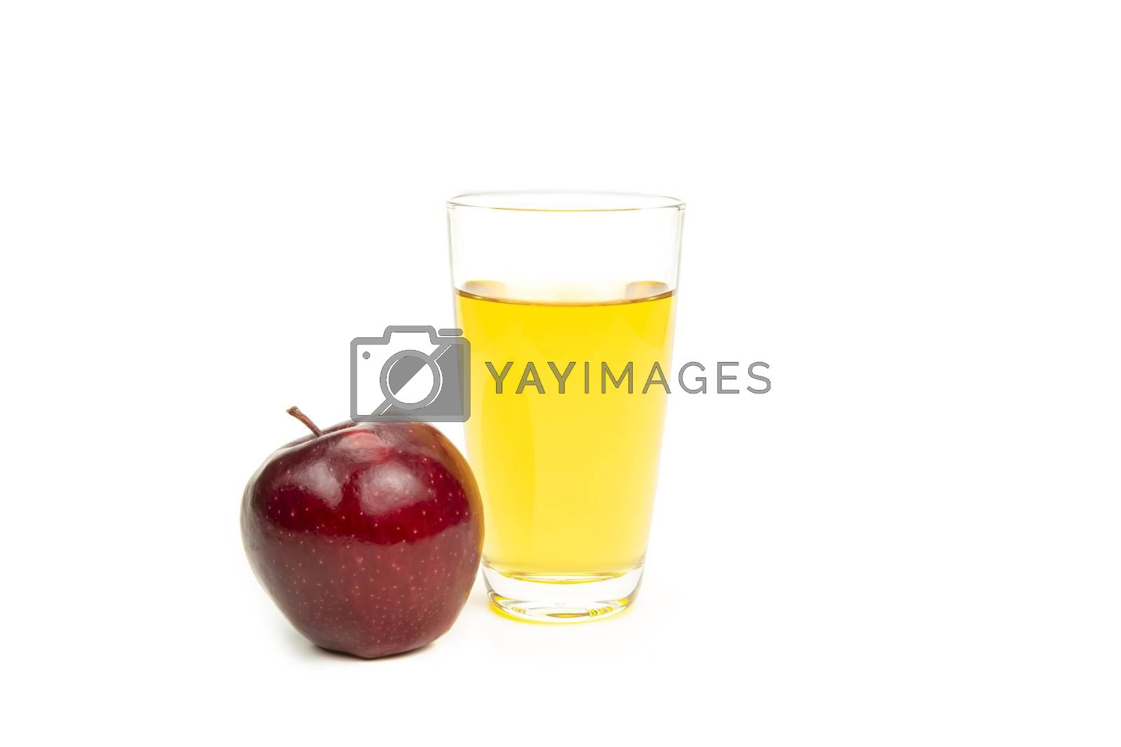 A glass of apple juice, isolated on white background