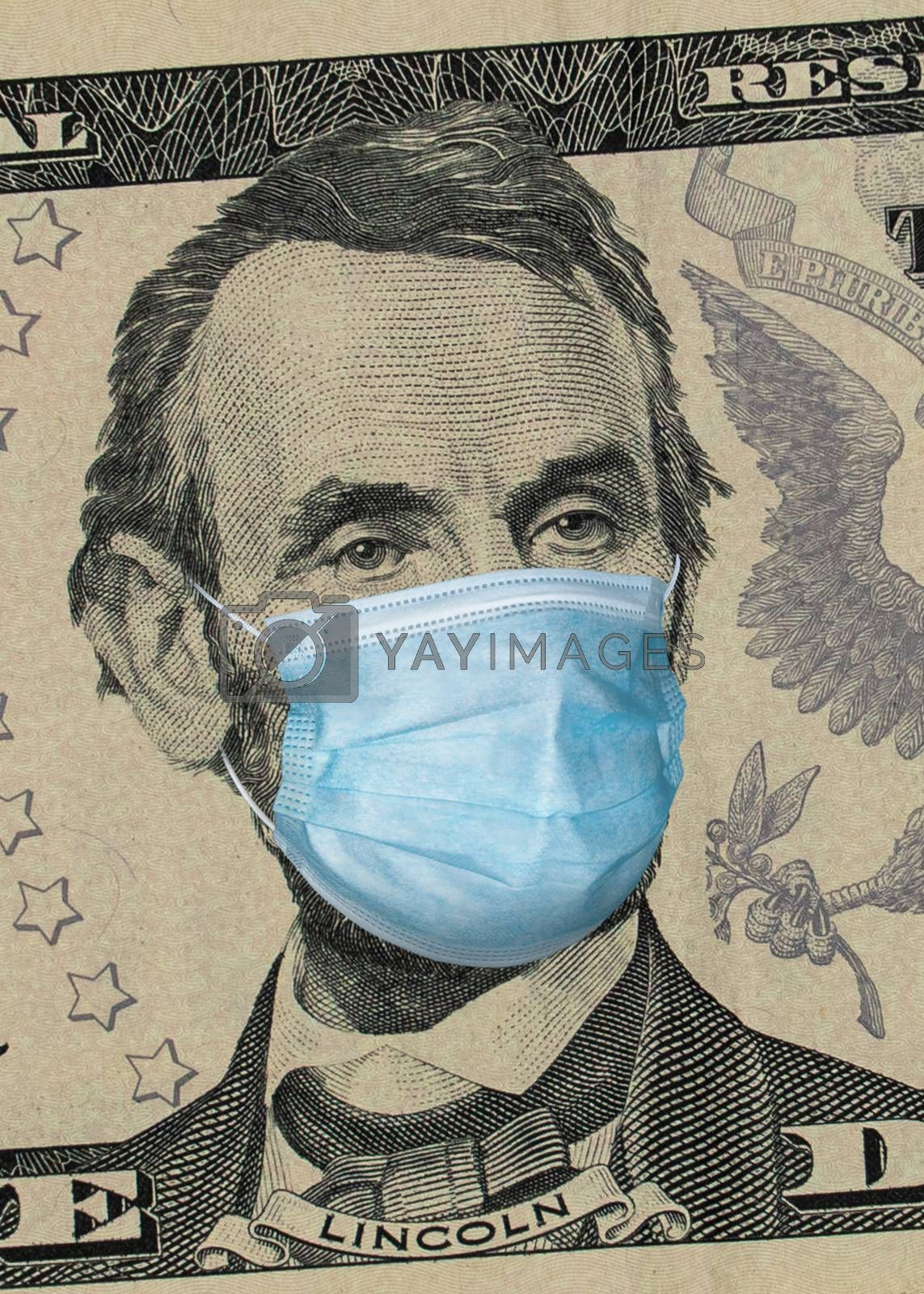 Five dollars banknote with Lincoln in a medical mask. Global financial and economic crisis has affected USA. American money, coronavirus concept. COVID-19 coronavirus in America.