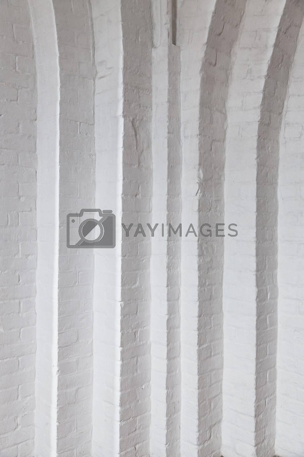 White brick wall with many corners. White room with white brick wall in the Gothic temple. Corner white brick wall texture.