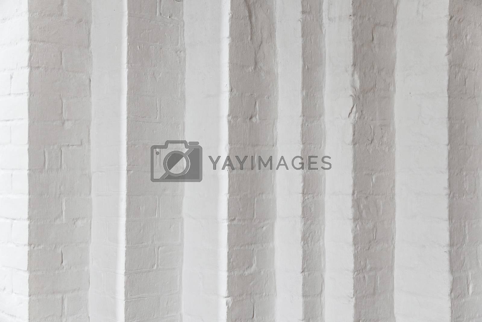 White brick wall with many corners. White room with white brick wall in the Gothic temple. Corner white brick wall texture, close up