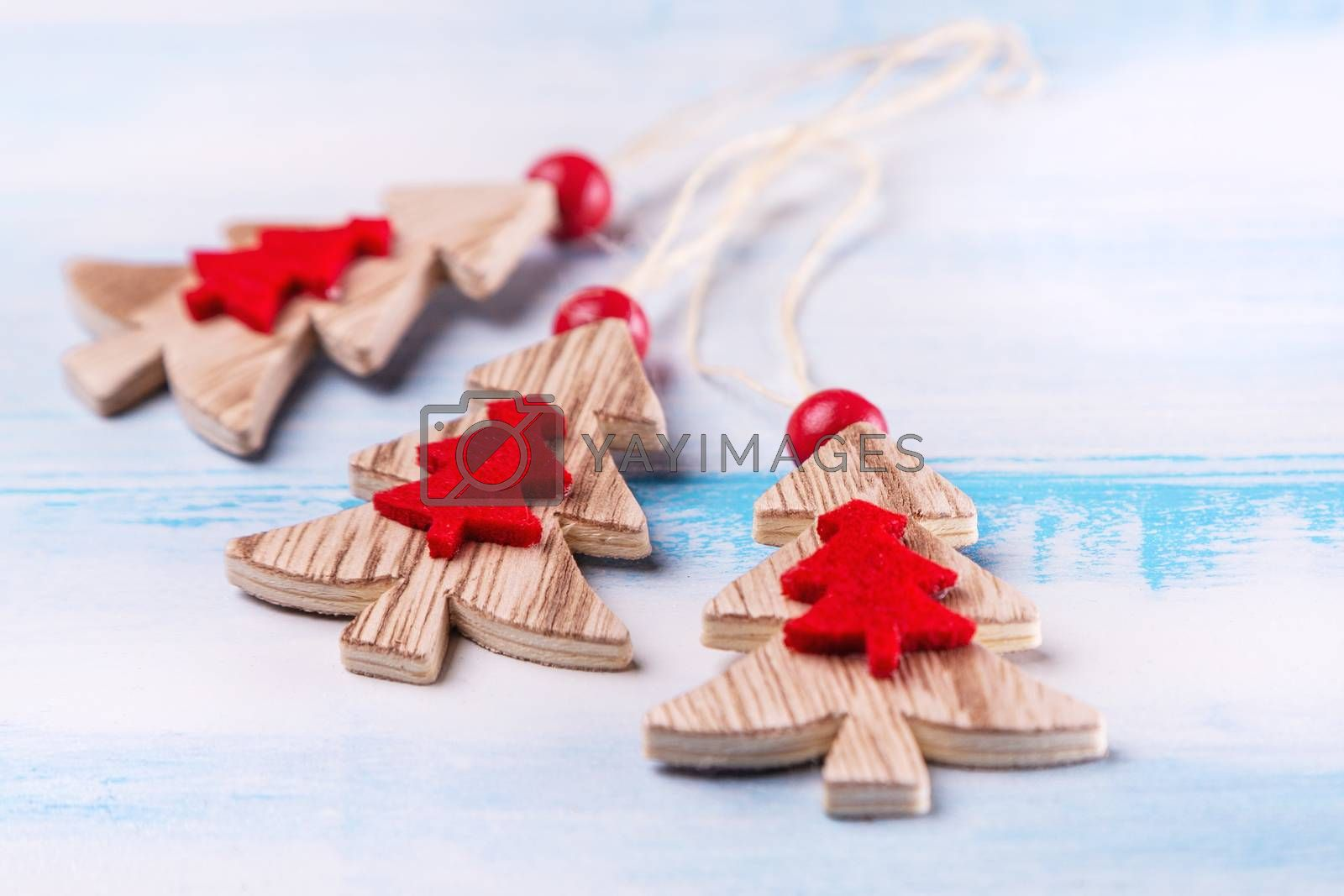 Christmas background with xmas tree, on a wooden blue and white background. Merry christmas card. Winter holiday theme. Happy New Year. Christmas decoration on wooden background, close-up.