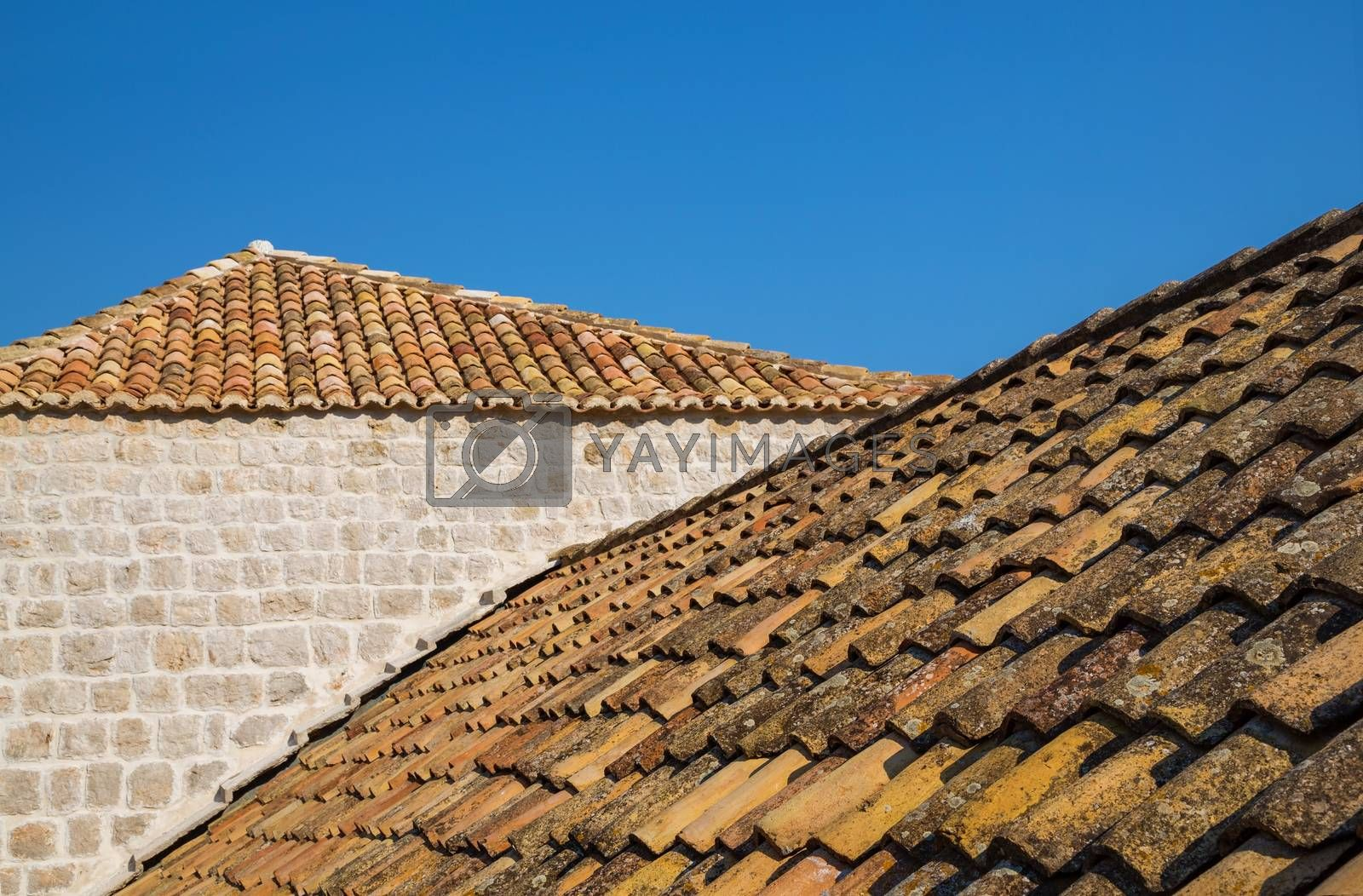 Traditional Mediterranean houses with red tiled roofs and Dubrovnik fortress bastions, Dalmatia, Croatia, Europe.