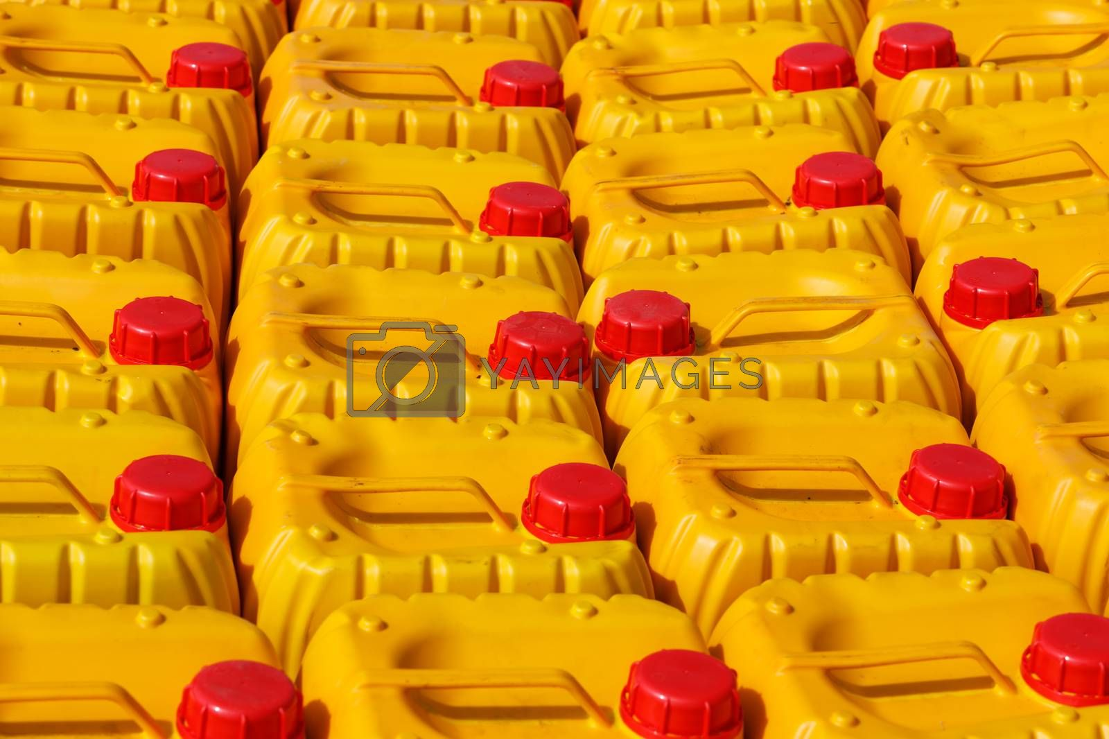 Group of traditional african yellow plastic canister for water or gasoline. Nosy Be, Madagascar