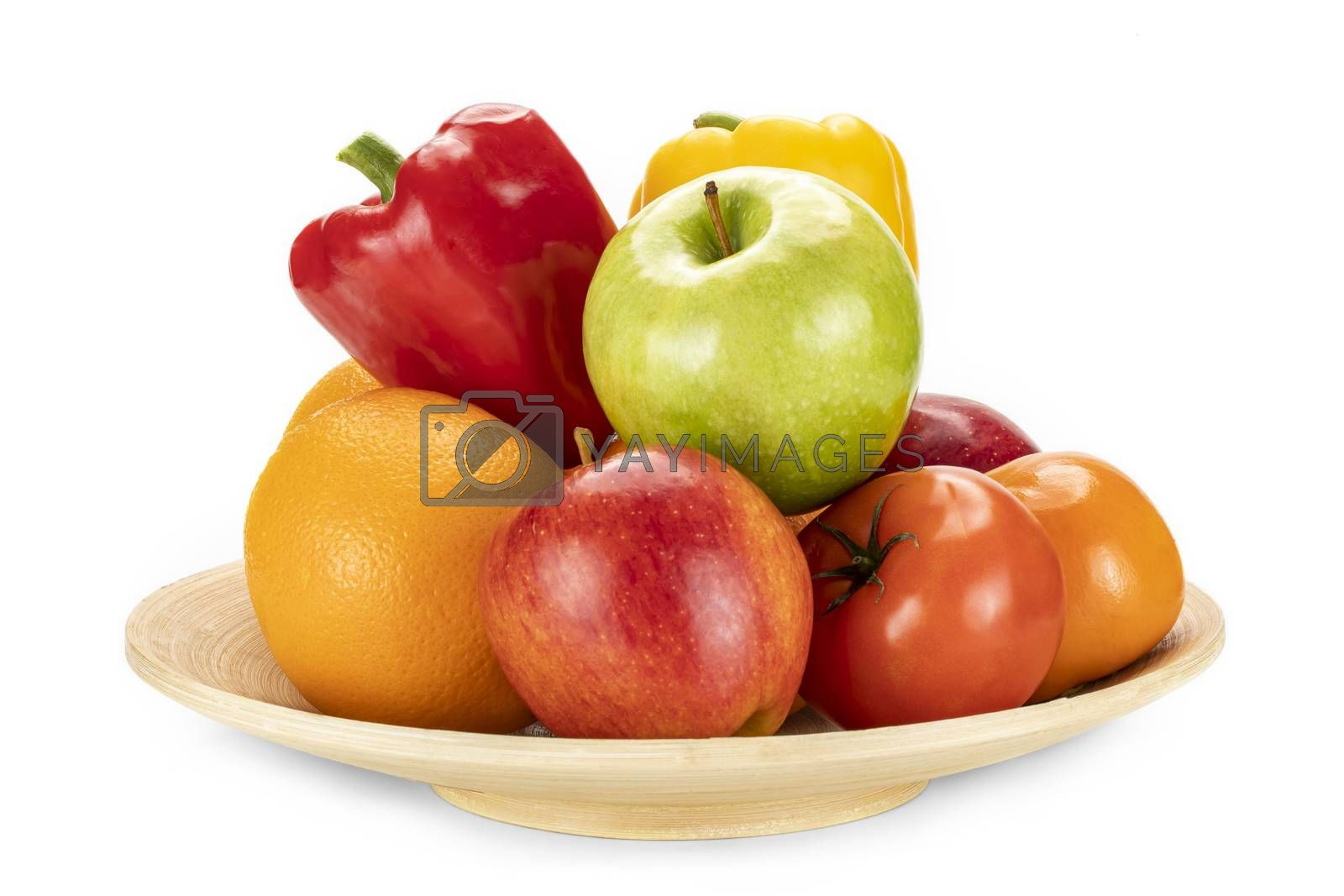 Plate of fresh ripe oranges, red, and green apples, persimmon, red and yellow bell peppers isolated on a white background.