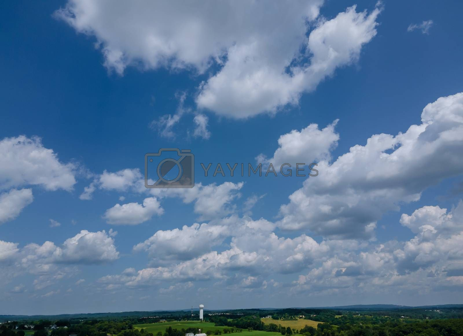 Cumulus cloud floated in beautiful blue azure sky with an amazing of white fluffy clouds