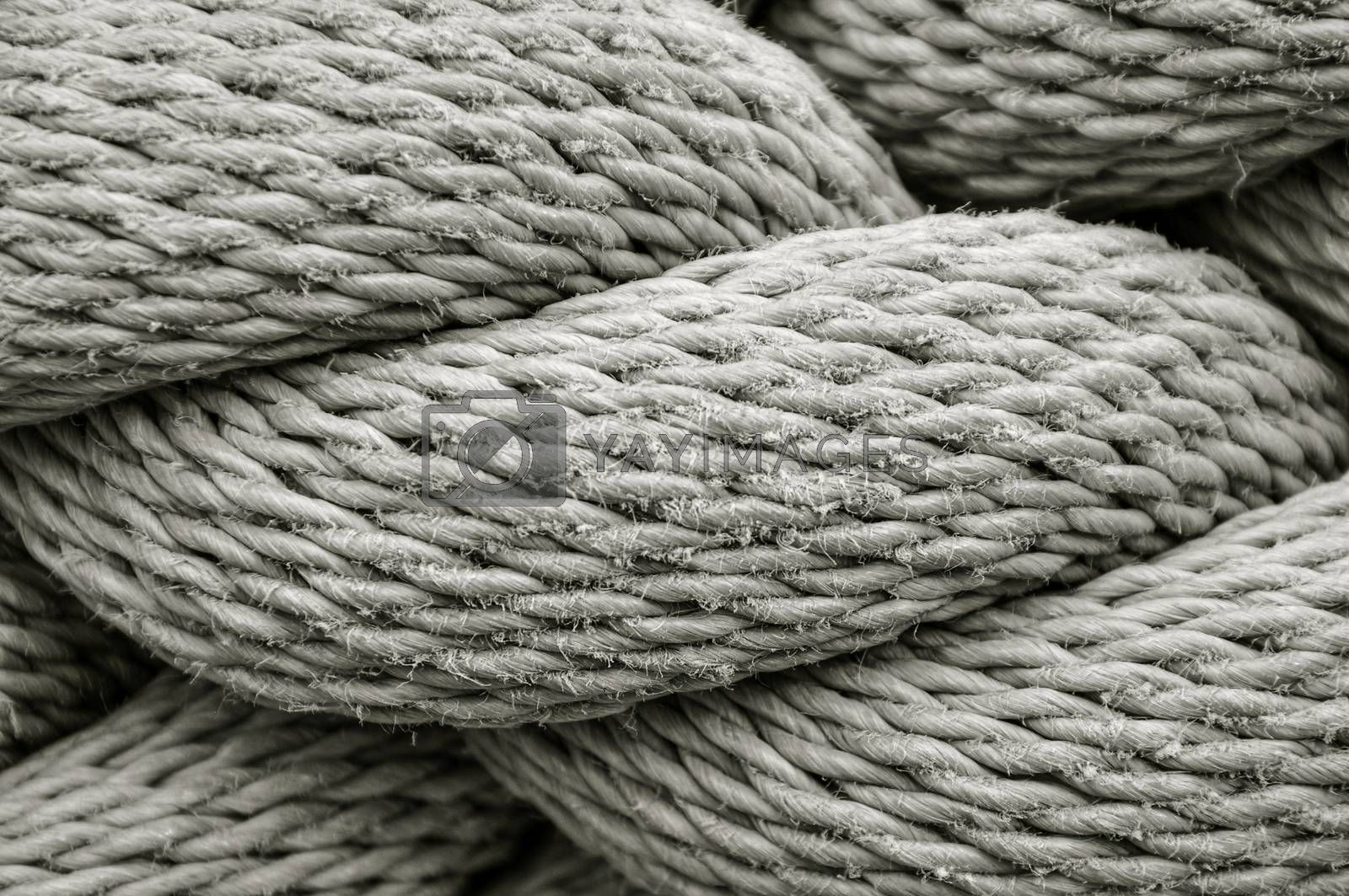 A close up view of a thick industrial rope showing all the threads and fibres