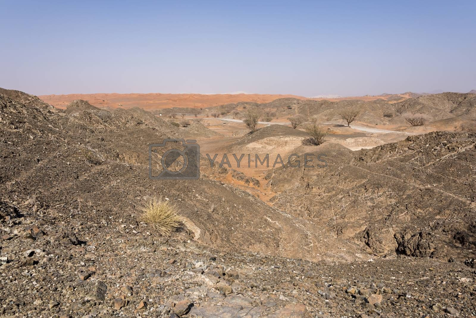 Scenic view of Wadi Al Ghail, with the mountain and the dunes. It is a village in between both desert (rocks and sand) and with amazing landscape all around Ras al Khaimah Emirates, UAE