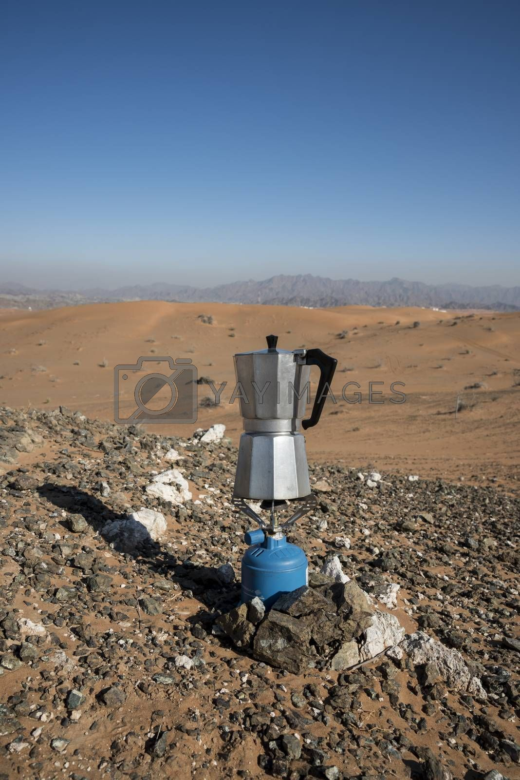 Italian Coffee maker at a fireplace in the desert on gaz by GABIS