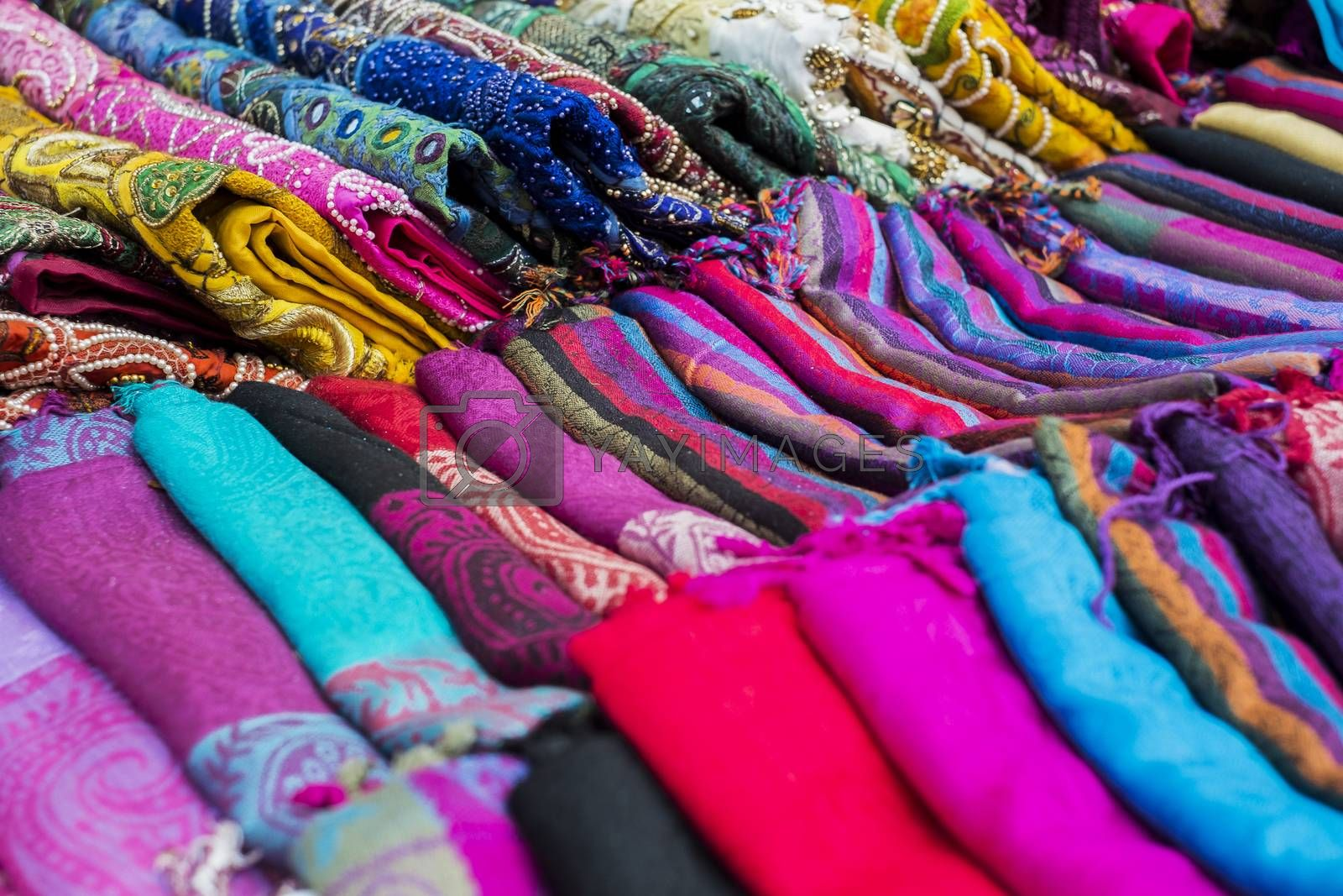 Multi-colored fabrics lie one on another