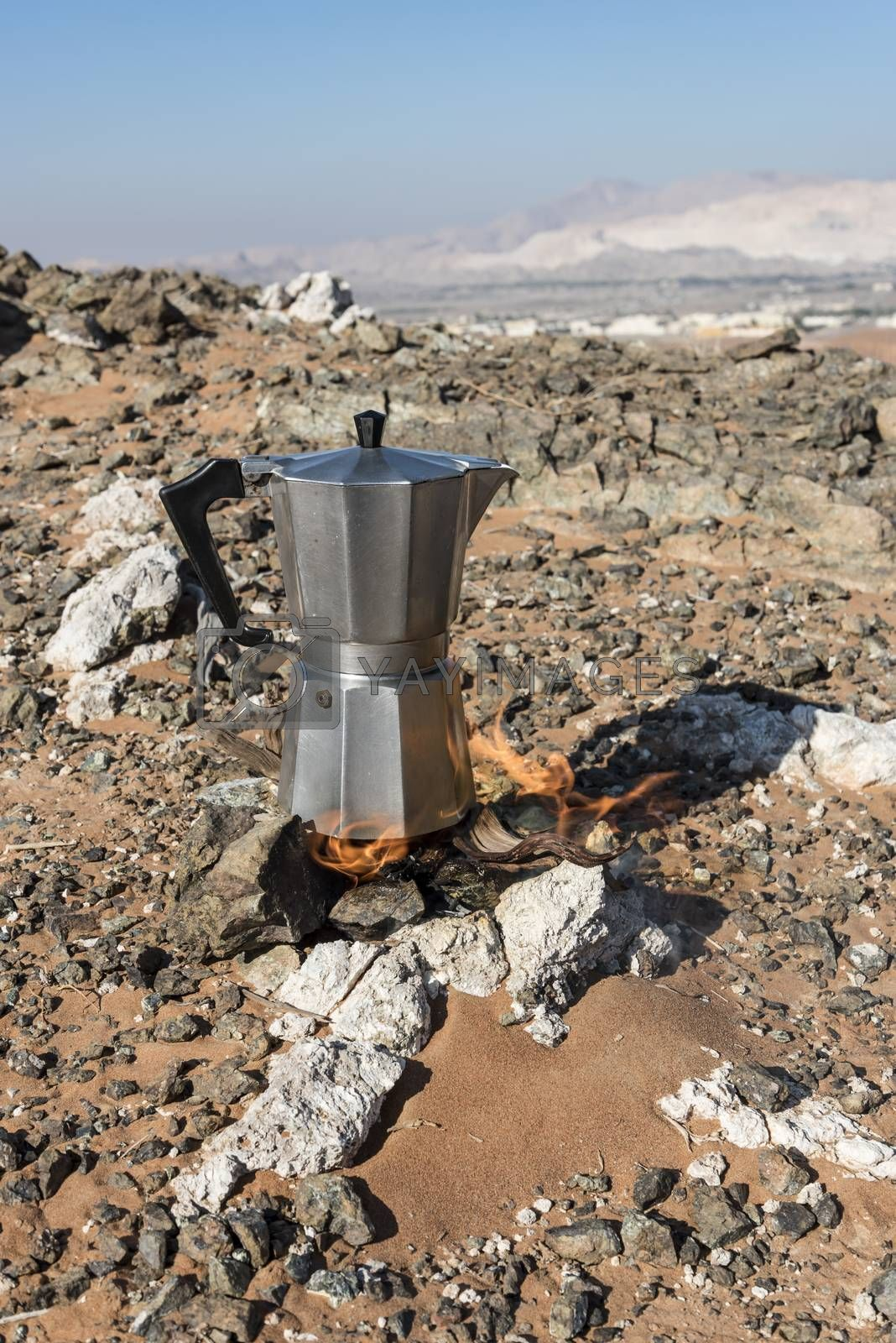 Italian Coffee maker at a fireplace in the desert