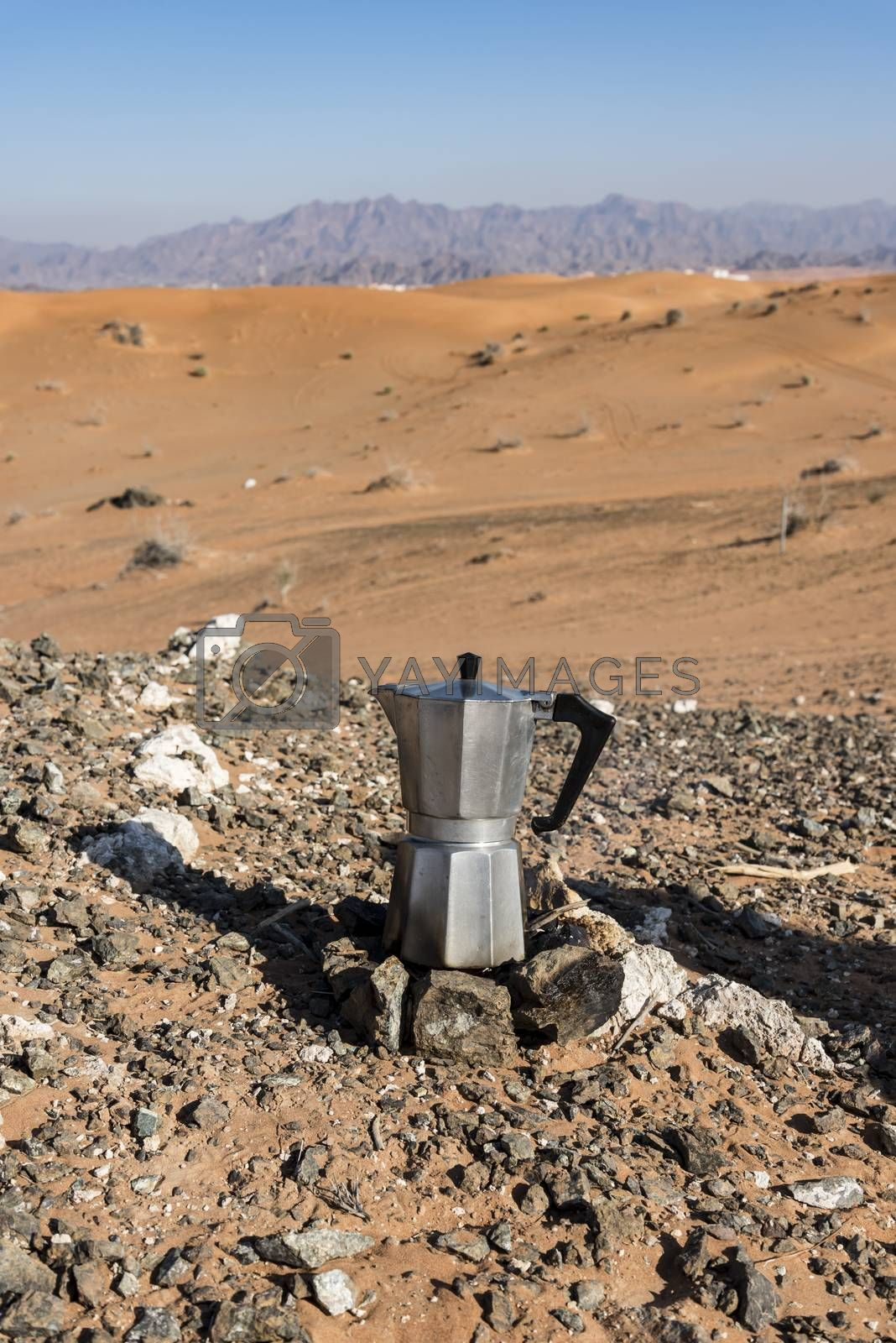 Italian Coffee maker at a fireplace in the desert by GABIS