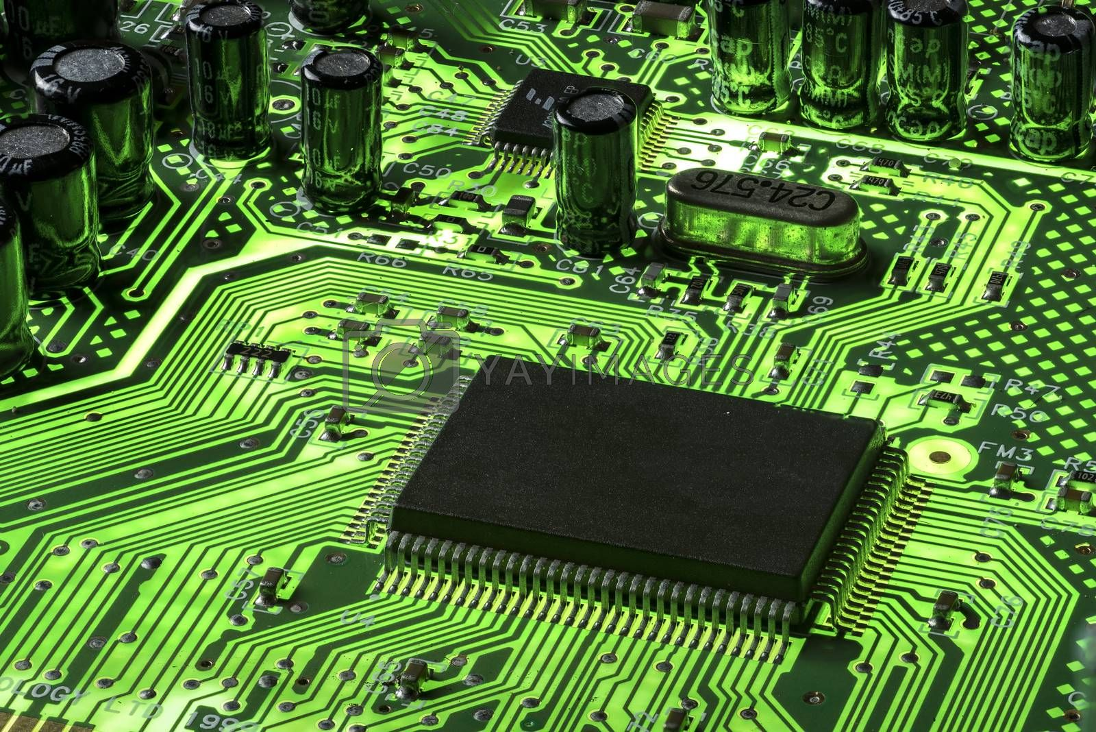 Green Mother board fluorescent with a black CPU and other components