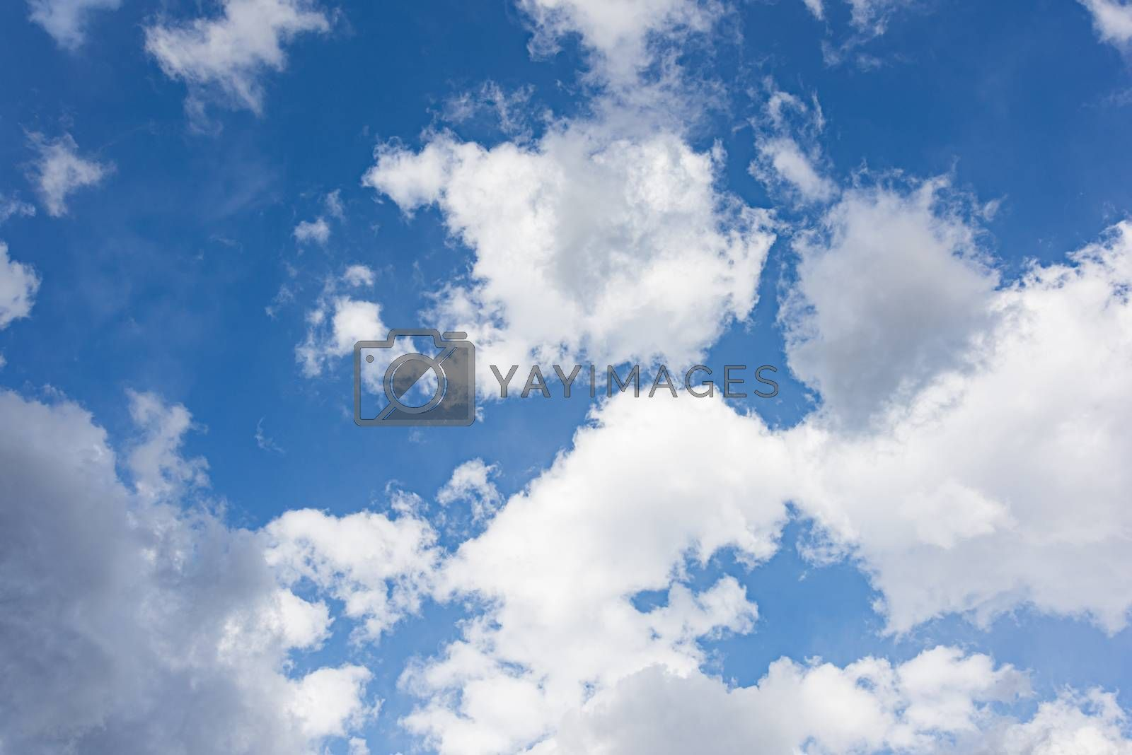 Royalty free image of Blue sky with white clouds and sun by GABIS