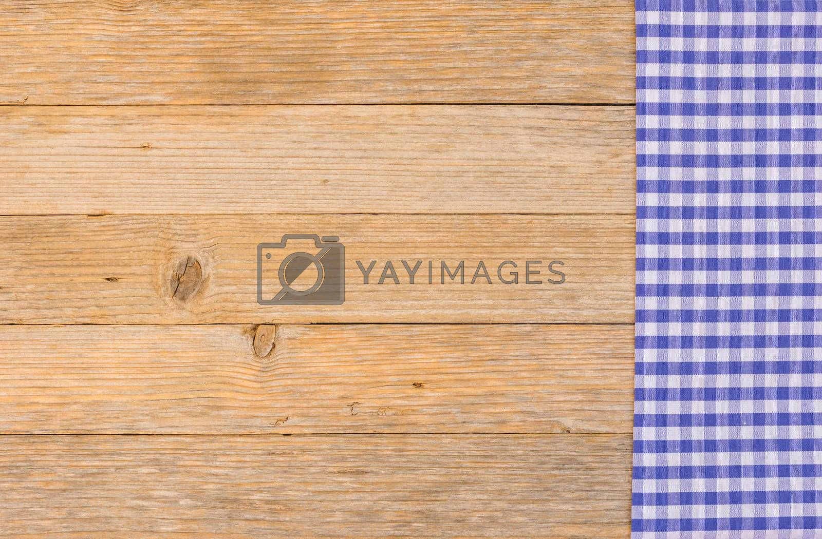 Blue tablecloth on wooden table with copy space, top view