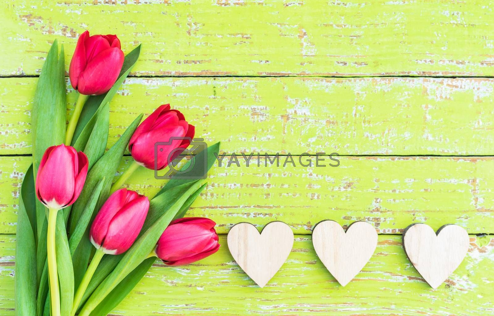 Romantic Valentines day background with red flowers and hearts