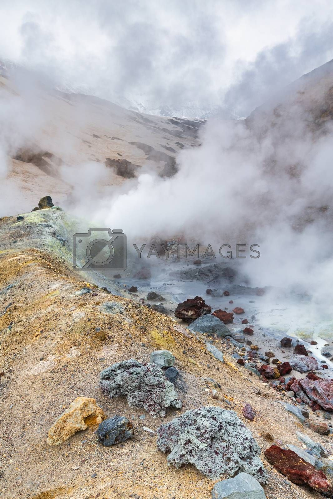 Mountain landscape, crater of active volcano: fumarole, hot spring, lava field, gas-steam activity. Dramatic volcanic landscape, popular travel destinations for active vacation, mount climbing, hiking
