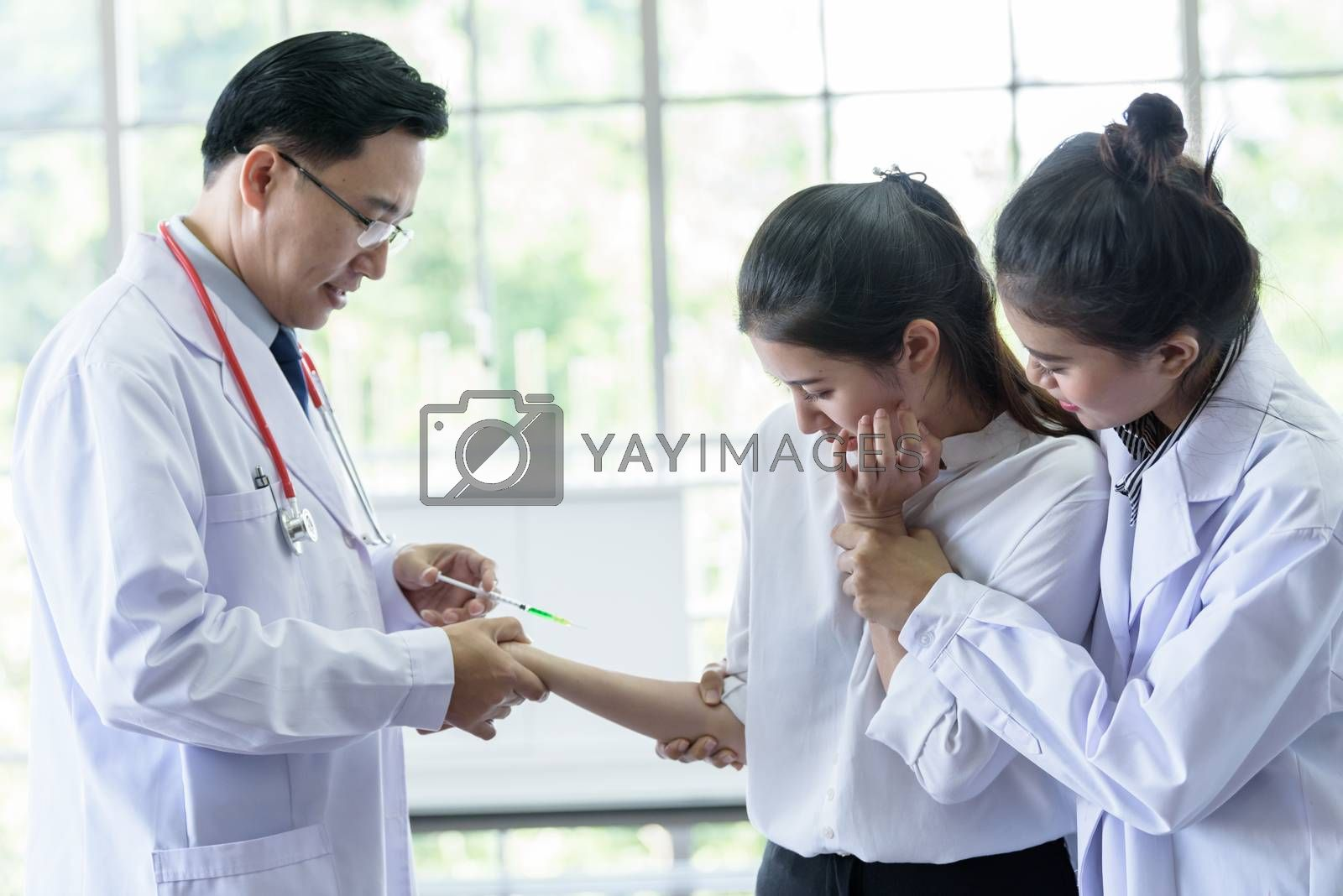 Patient has afraid and scary of syringe and needle. by animagesdesign