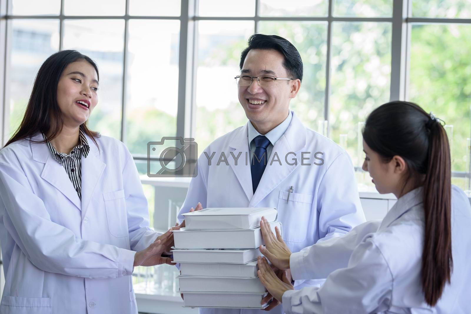 Senior asian scientist has assigning new job to students in laboratory.