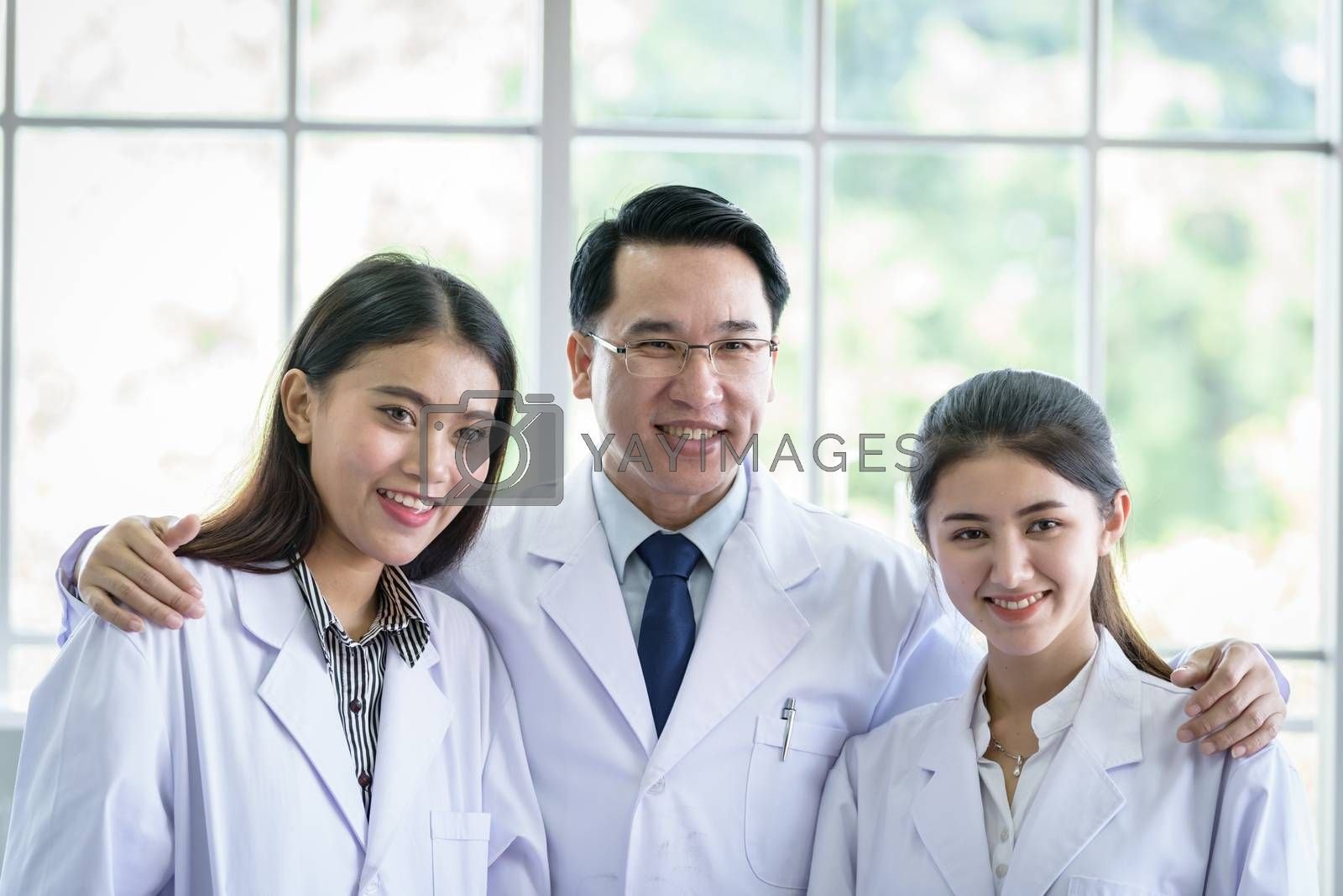 Asian scientist and researching team has in laboratory.