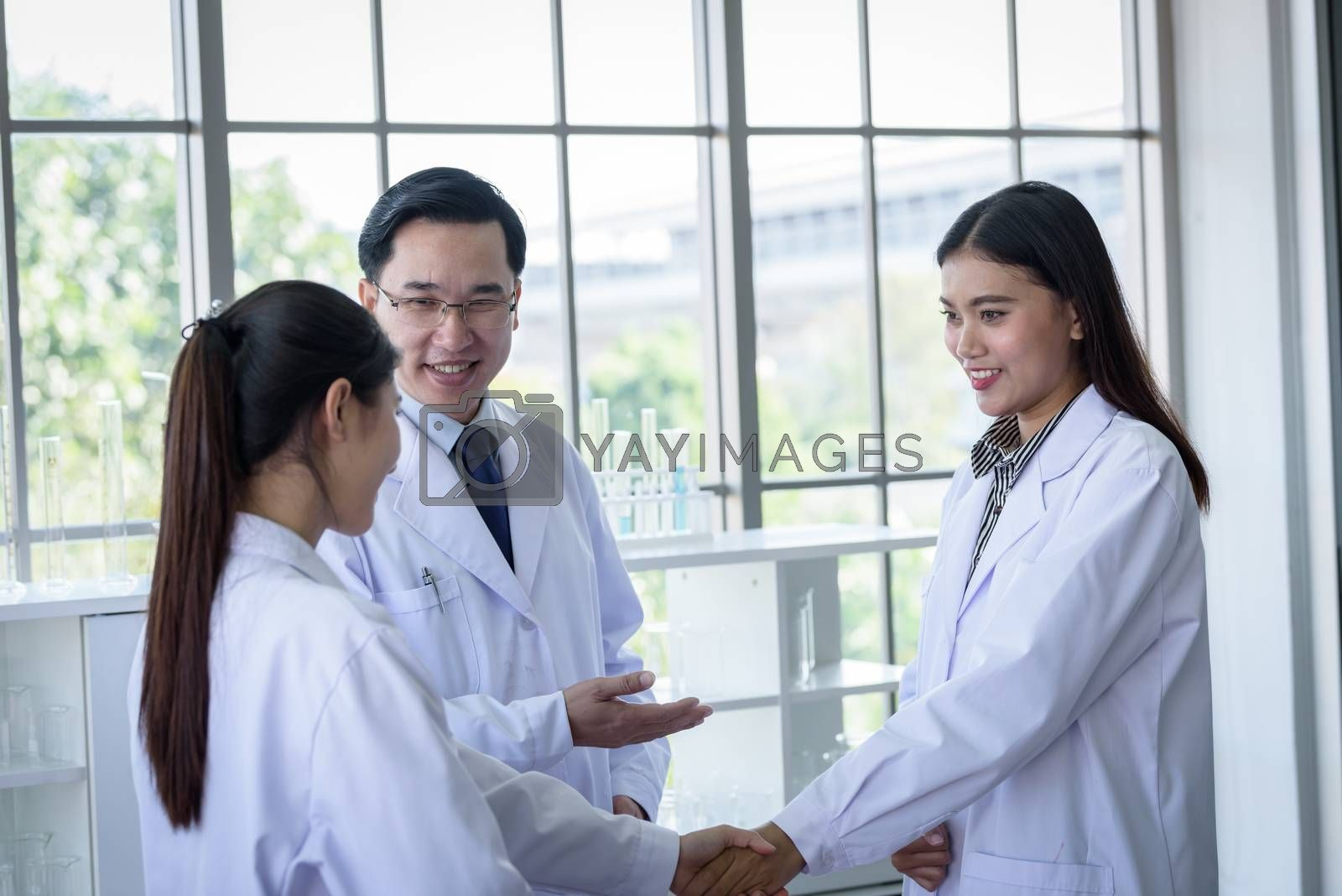 Asian scientist team have meeting in laboratory.