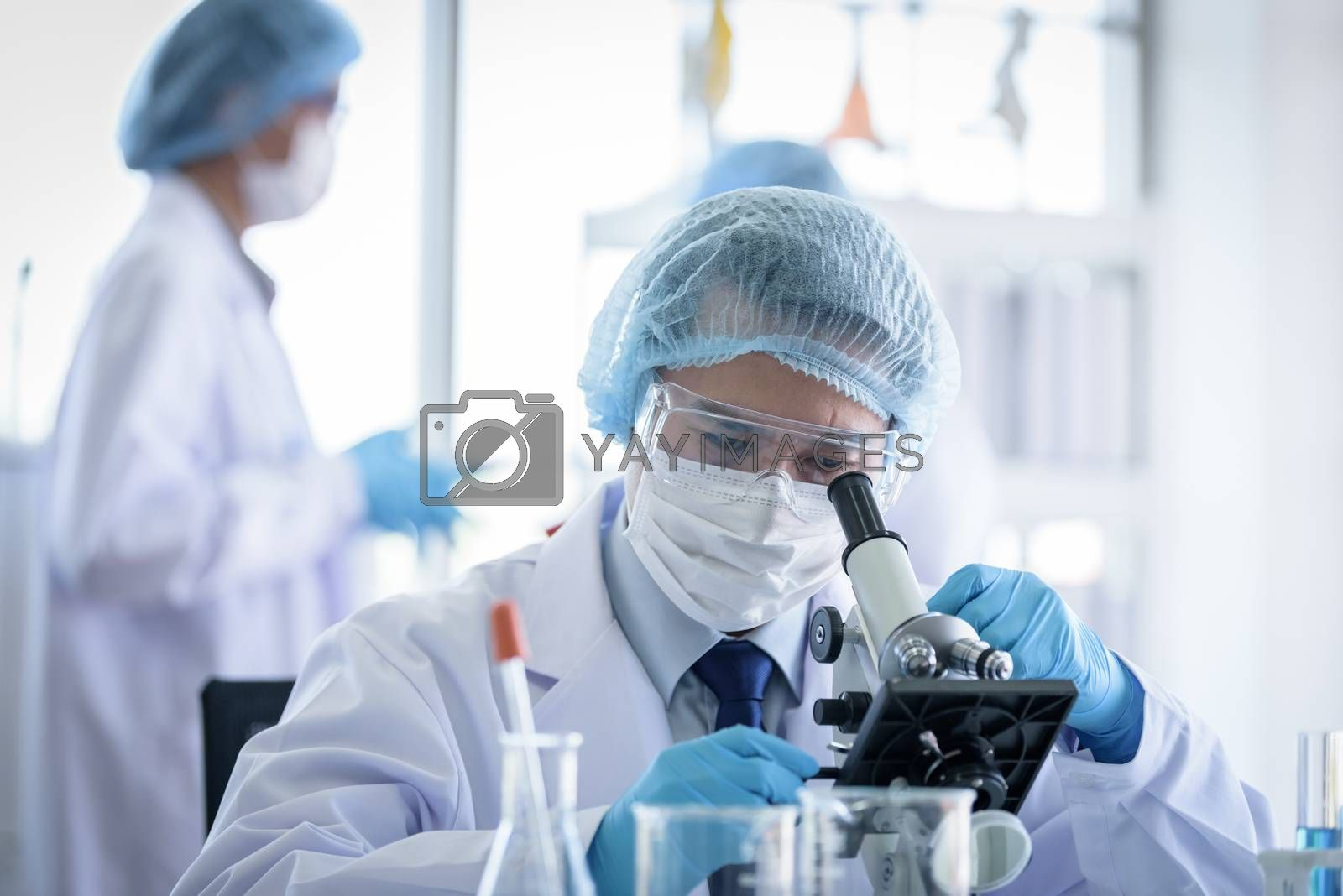 Asian scientist team has researching in laboratory.