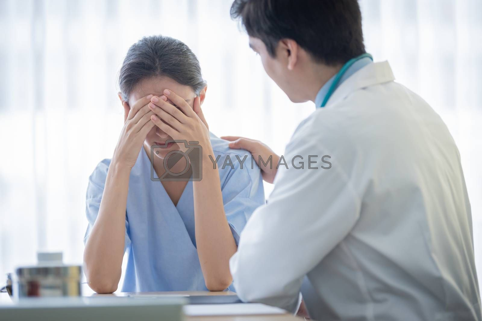 A doctor takes care of a sick patient woman with sadness and unhappiness at the hospital or medical clinic.