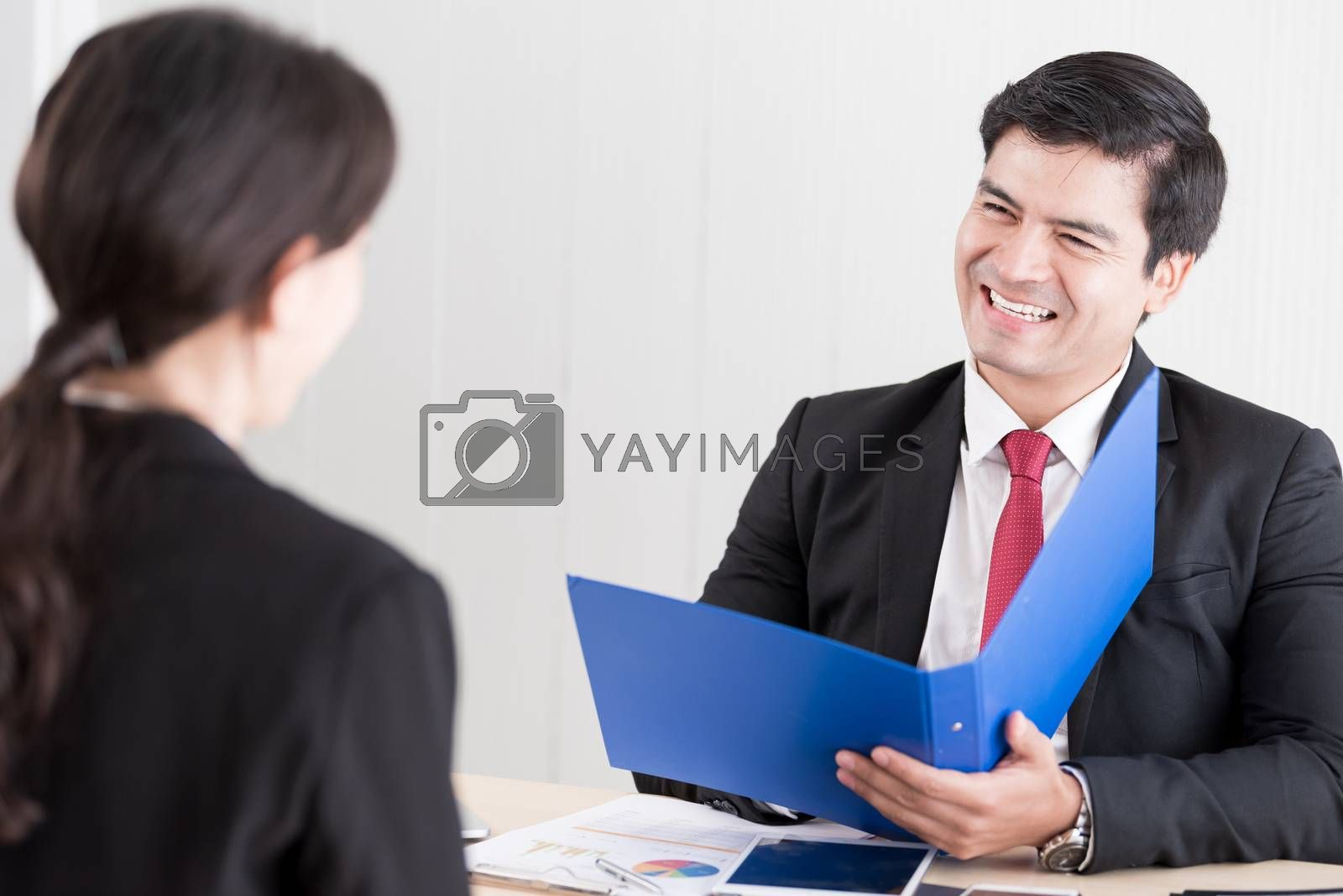 A businessman listens and talking to candidate woman answers for a job interview.