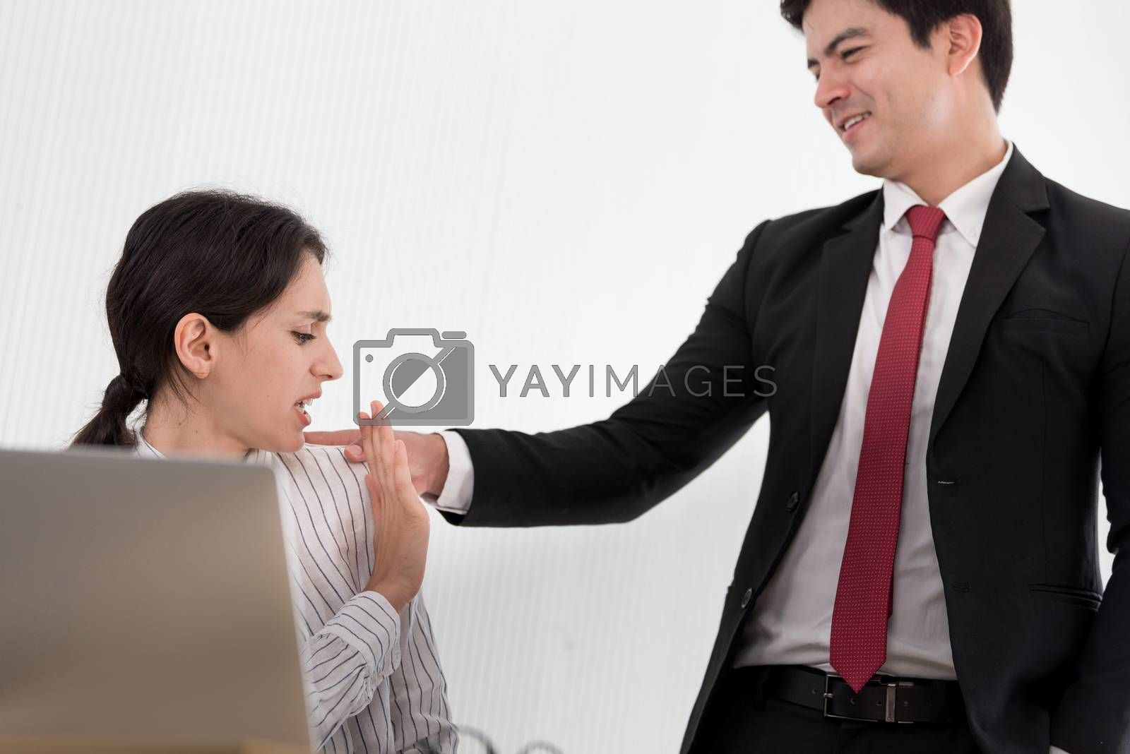 The uncomfortable scared woman and worry by her boss at the office in Sexual harassment at the workplace.