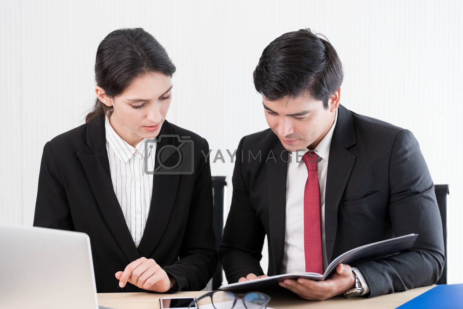 A manager and secretary working together in the office.