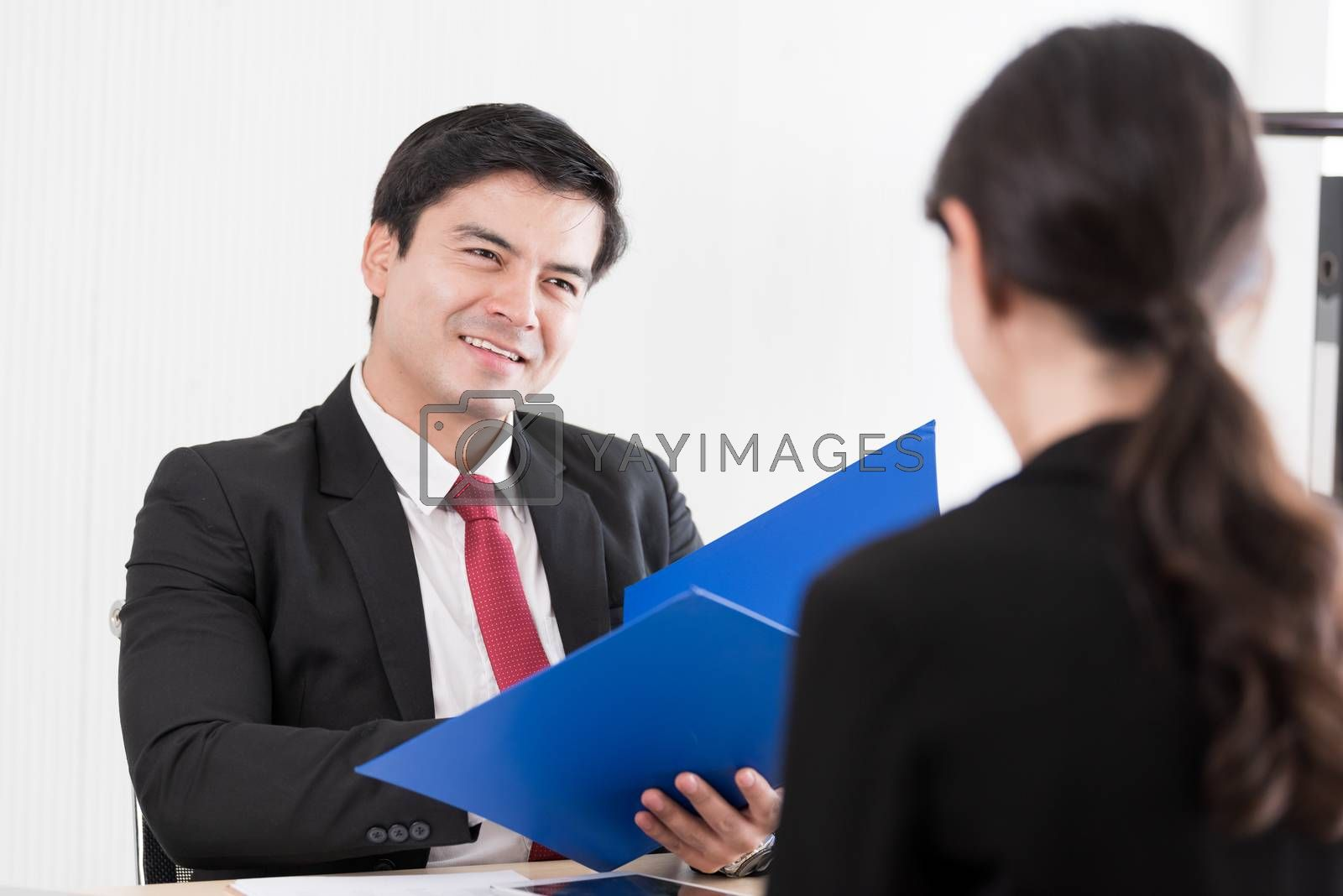 A businessman listens and talking to candidate woman answers for by animagesdesign
