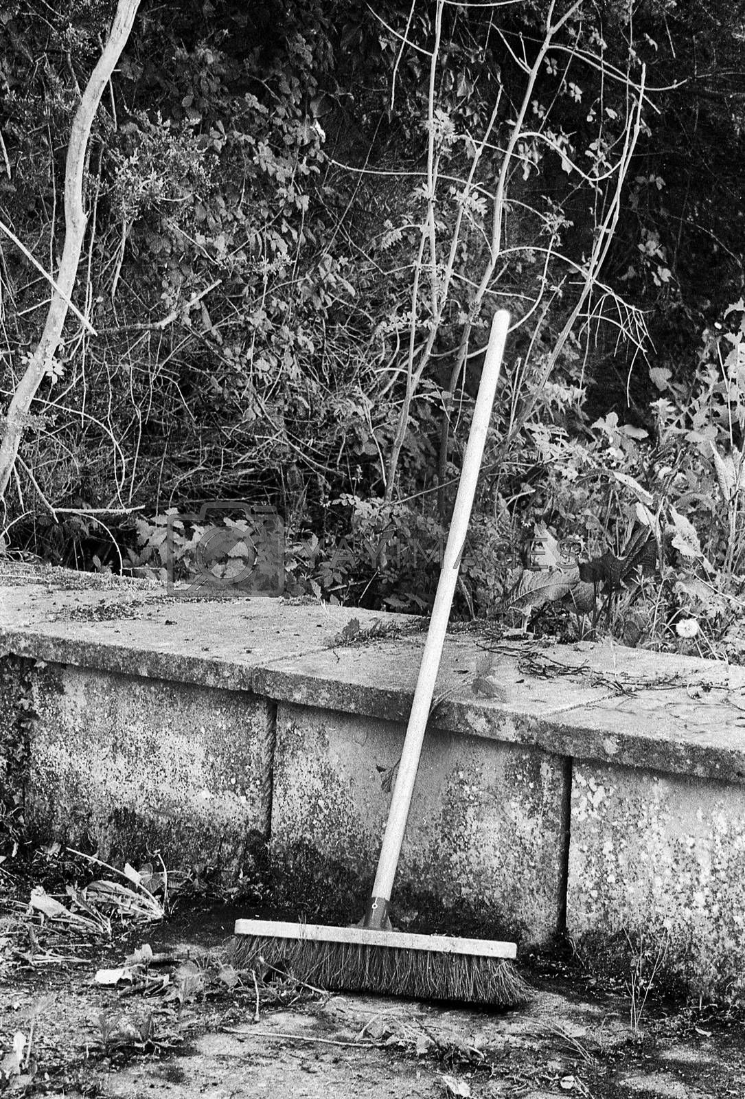 tidy the garden in summer and sweep it with the broom, this black and white photo was taken with a pinhole film camera, which corresponds to the camera characteristic
