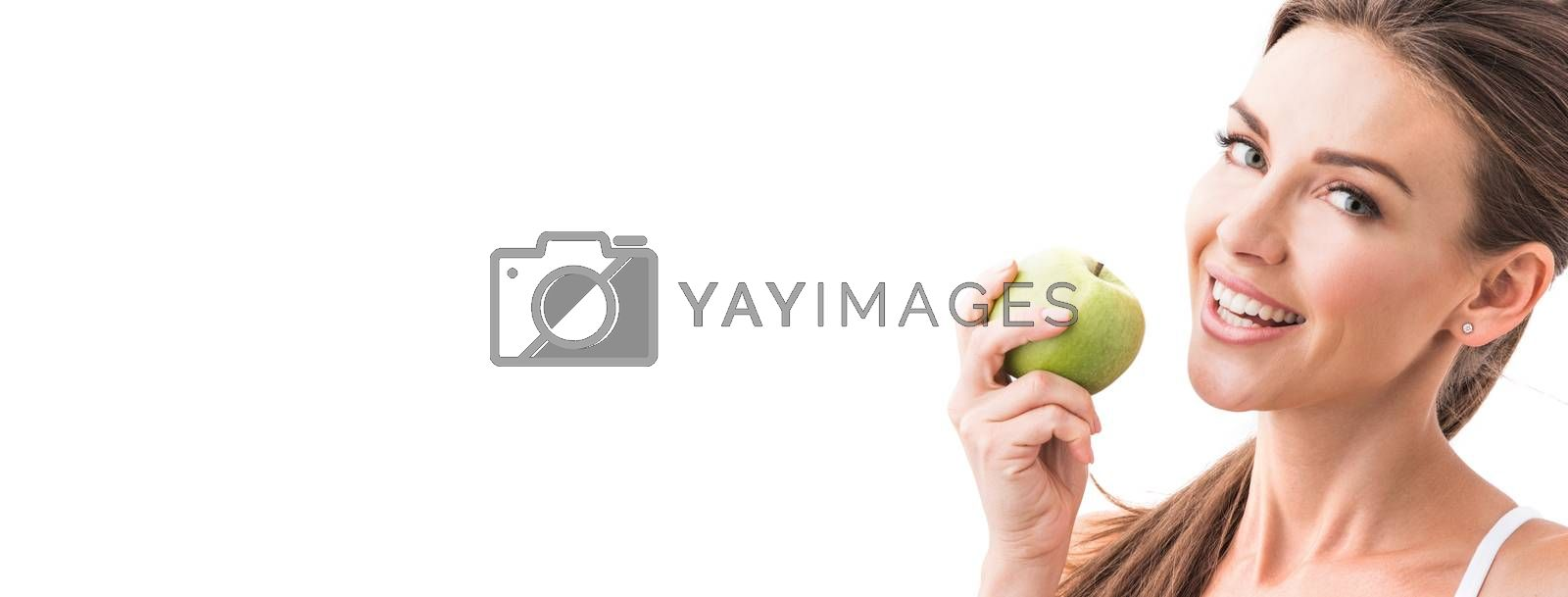 Woman eat green apple isolated on white background with copy space for text
