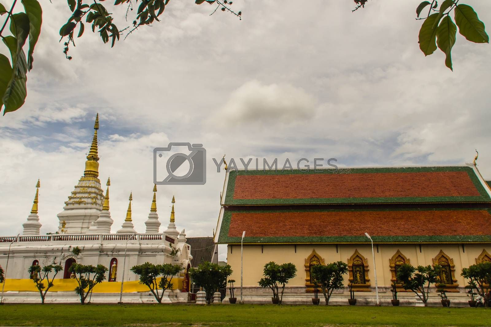 Beautiful landscape and white gold pagoda of Wat Jedyod, Chiang Rai, Thailand. Wat Chet Yot is a temple that has been renovated from the remains of an ancient temple.