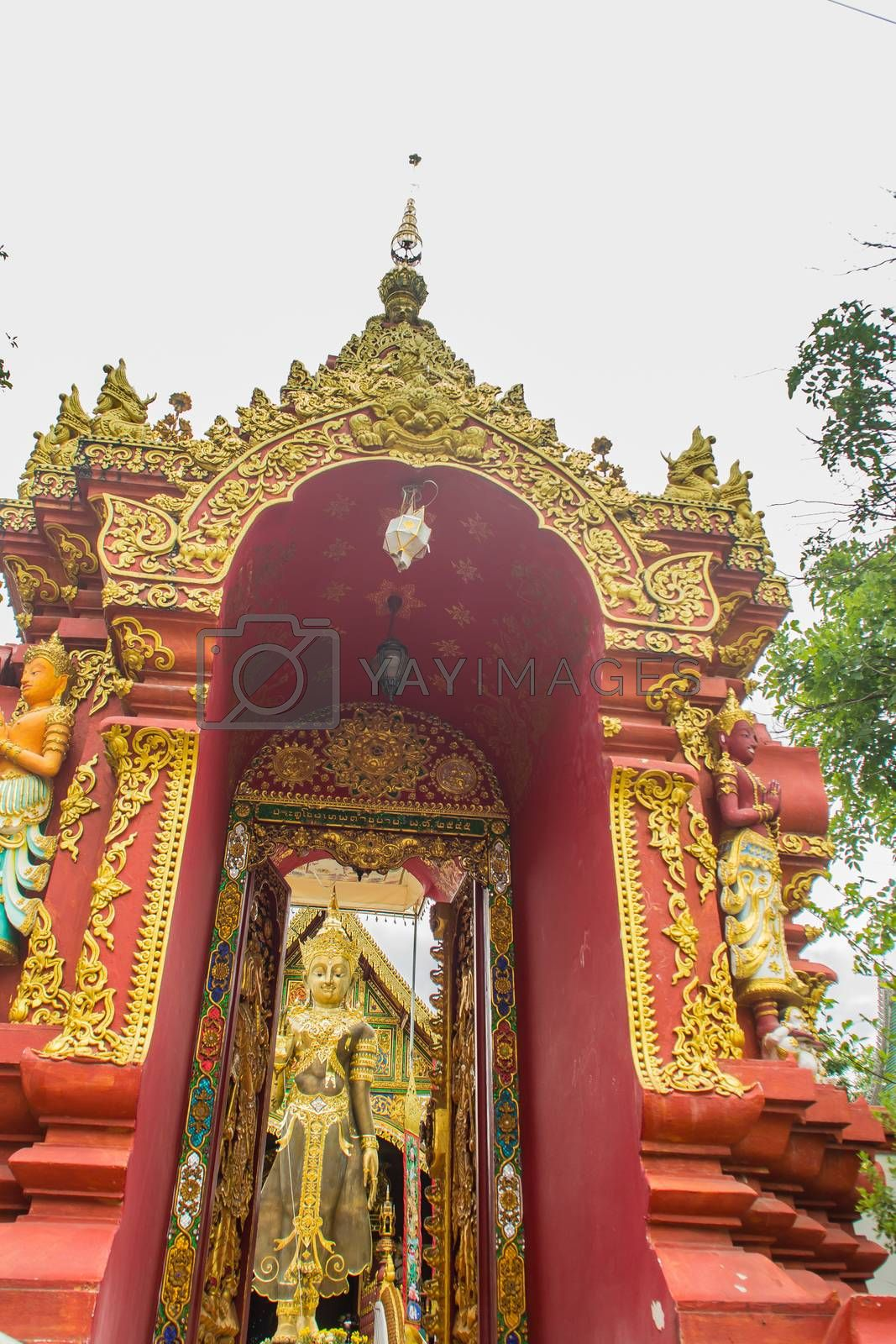 Beautiful art of Buddha image, religious places and religious objects in Myanmar mixed with Lanna style at Wat Ming Muang Buddhist temple, Chiang Rai, Thailand. Mixed Lanna and Burmese arts.
